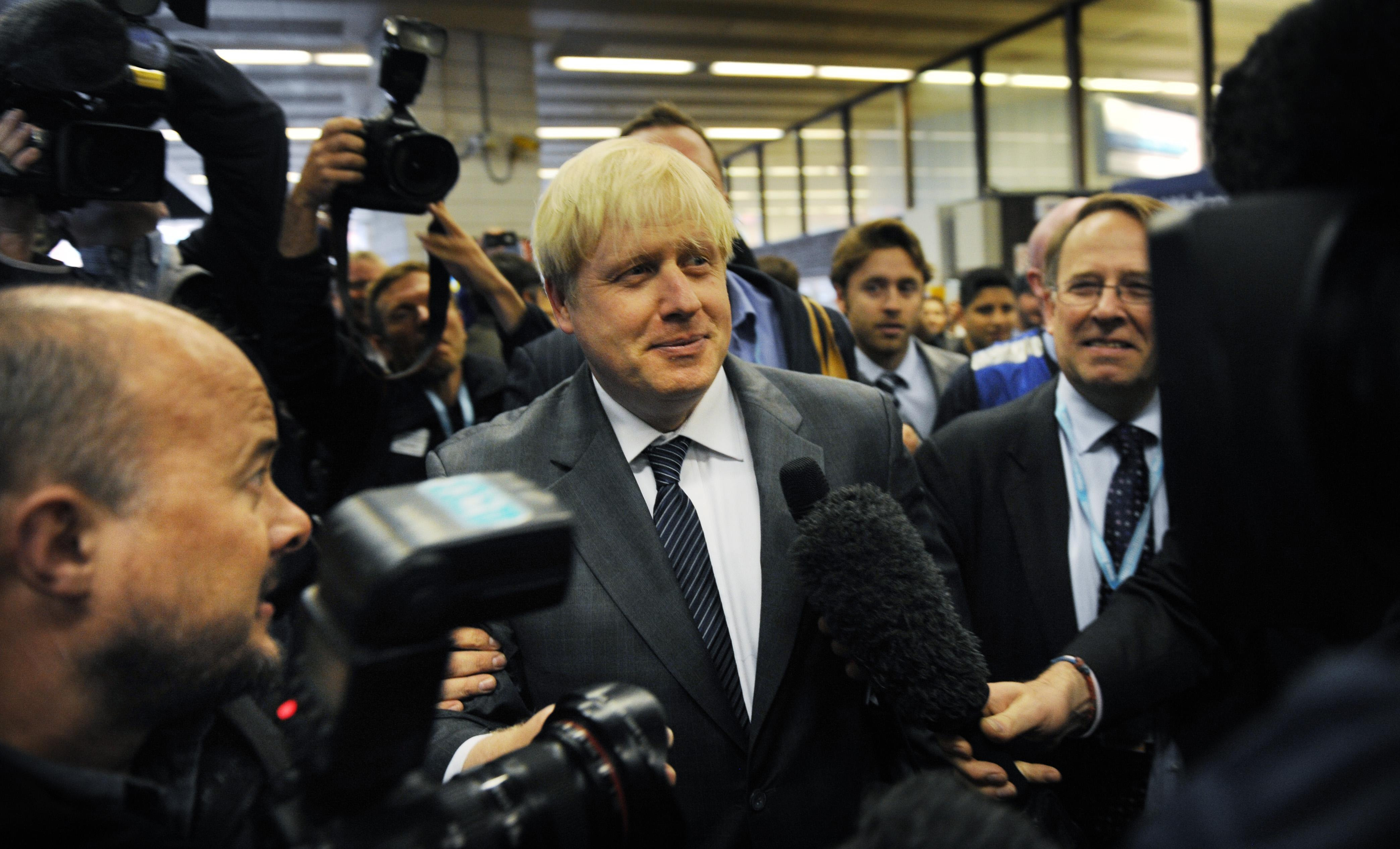 London Mayor Boris Johnson arrives at Birmingham New Street Station before attending the Conservative Party conference today.