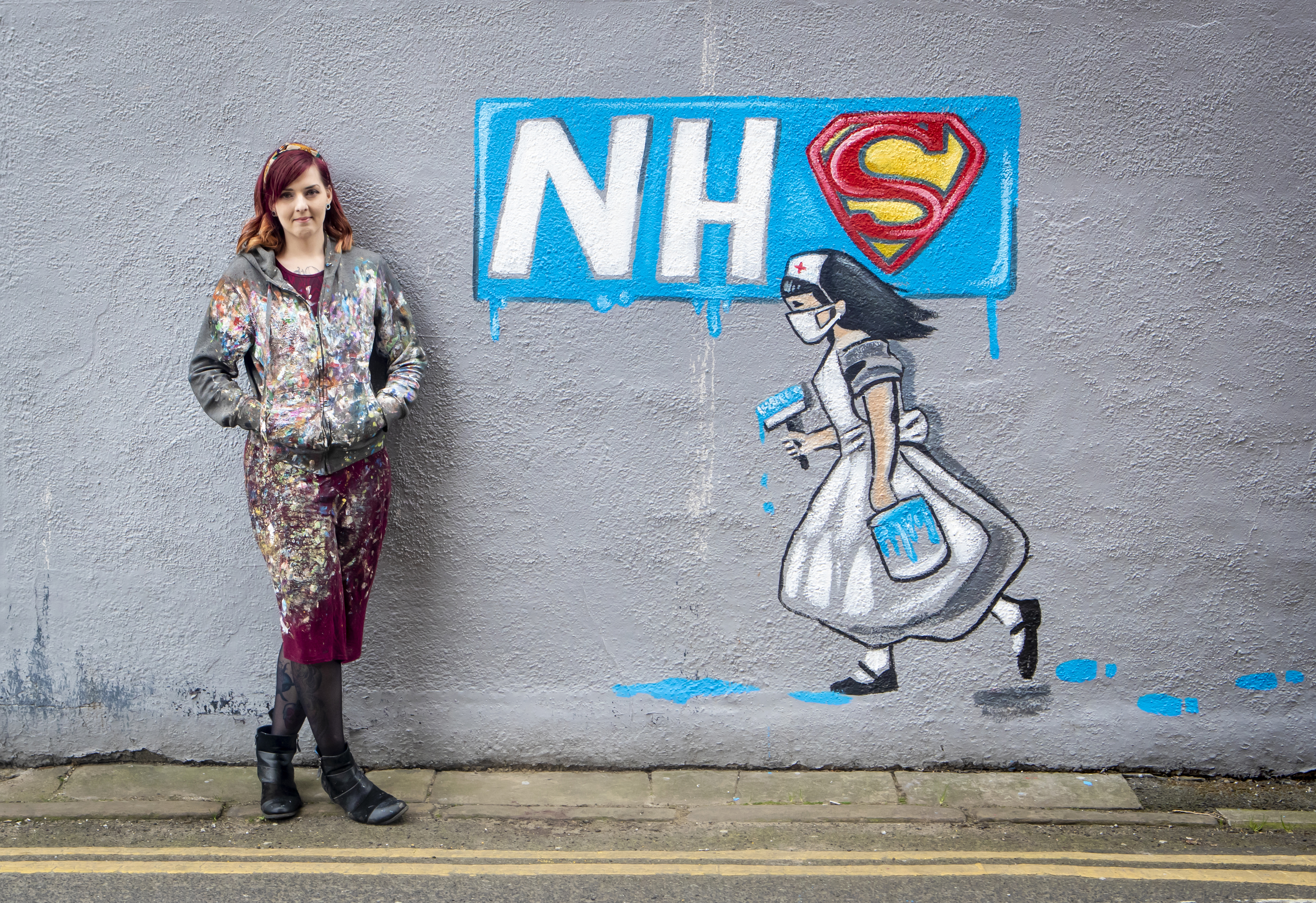 Artist Rachel List with her mural supporting the NHS on the side of Horse Vaults pub in Pontefract, Yorkshire, as the UK continues in lockdown to help curb the spread of the coronavirus.