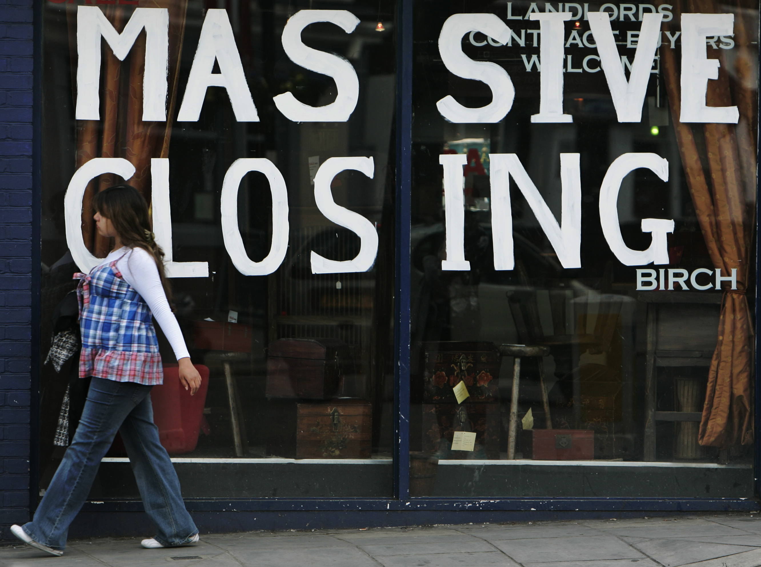 A woman walks past a shop with closing down sales signs, in west London, Friday May 1, 2009. Company insolvencies in England and Wales jumped 56 percent in the first quarter compared to a year ago, while individual insolvencies rose 19 percent, the government said Friday in its latest count of casualties in the recession. The Insolvency Service said there were 4,941 liquidations in the first quarter, up 7.1 percent from the previous quarter. In the 12 months through the first quarter, about 1 of every 130 companies went into liquidation, it added.The 29,774 individual insolvencies reported was up 1.6 from the previous quarter. (AP Photo/Lefteris Pitarakis)