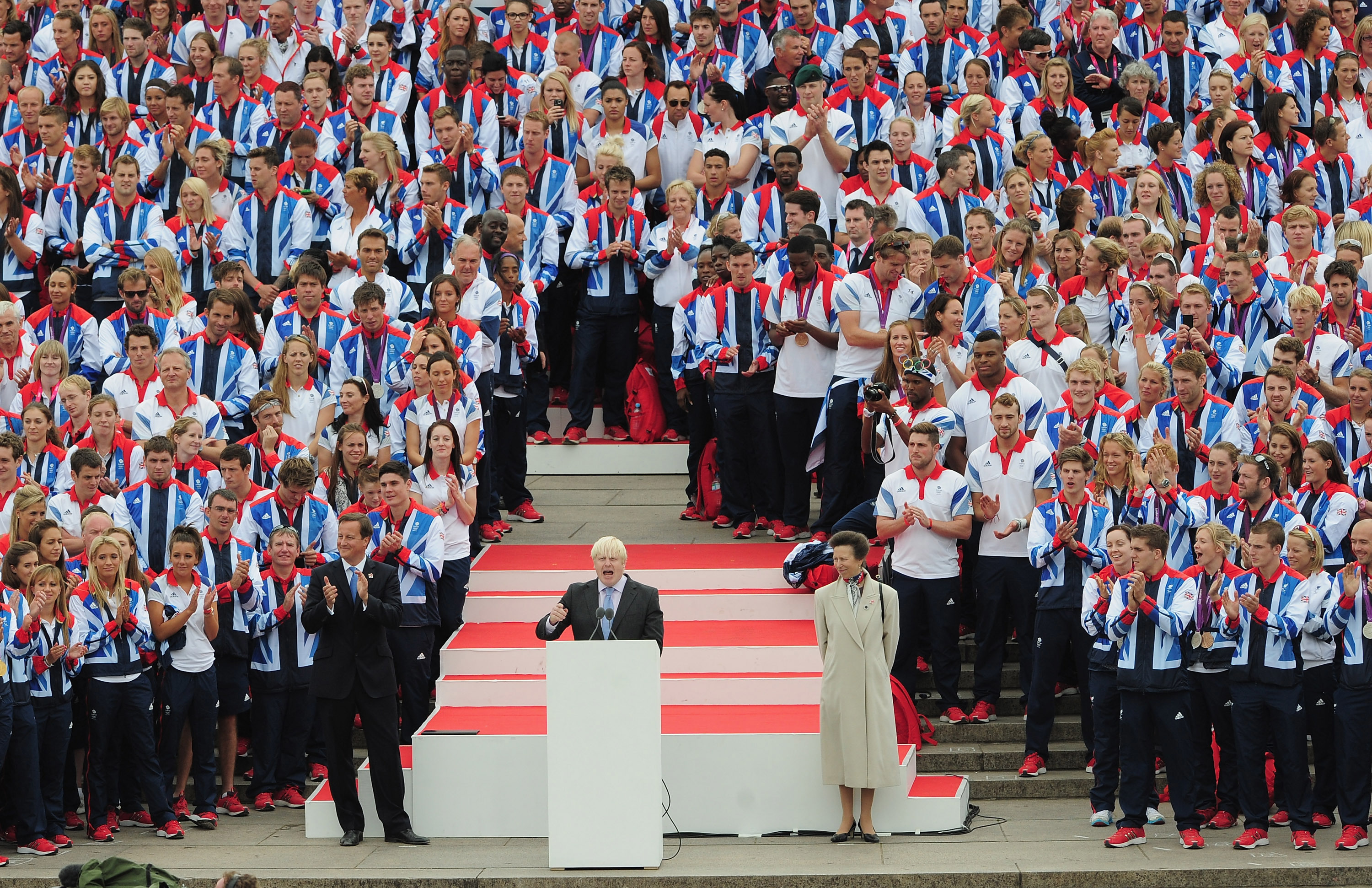 Mayor of London Boris Johnson addresses the athletes and fans from the QVM during the London 2012 Victory Parade for Team GB and Paralympic GB athletes in London, England.