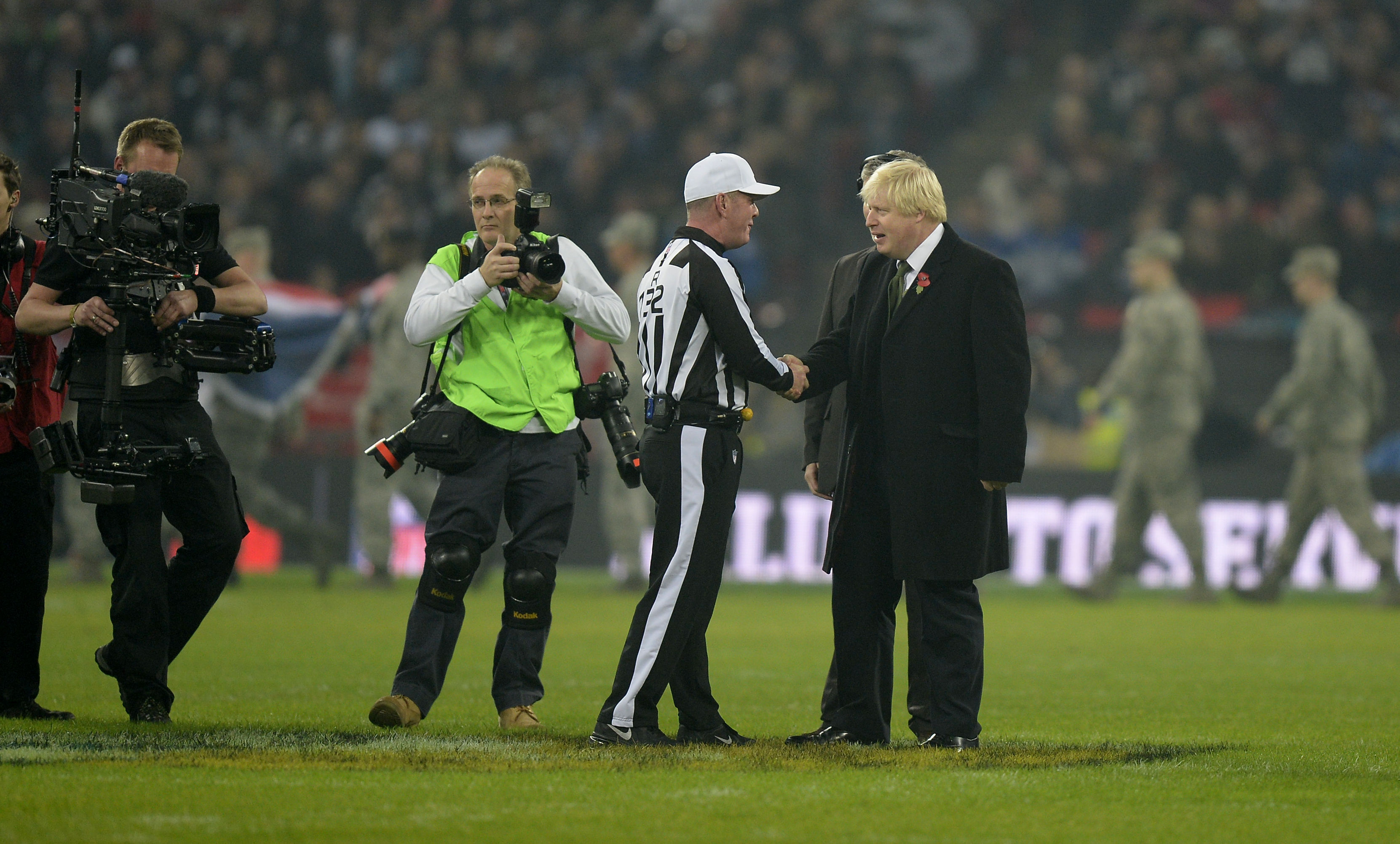 London Mayor Boris Johnson takes to the pitch before the NFL International match at Wembley Stadium, London. Picture date: Sunday November 9, 2014. See PA story GRIDIRON NFL. Photo credit should read: Andrew Matthews/PA Wire.