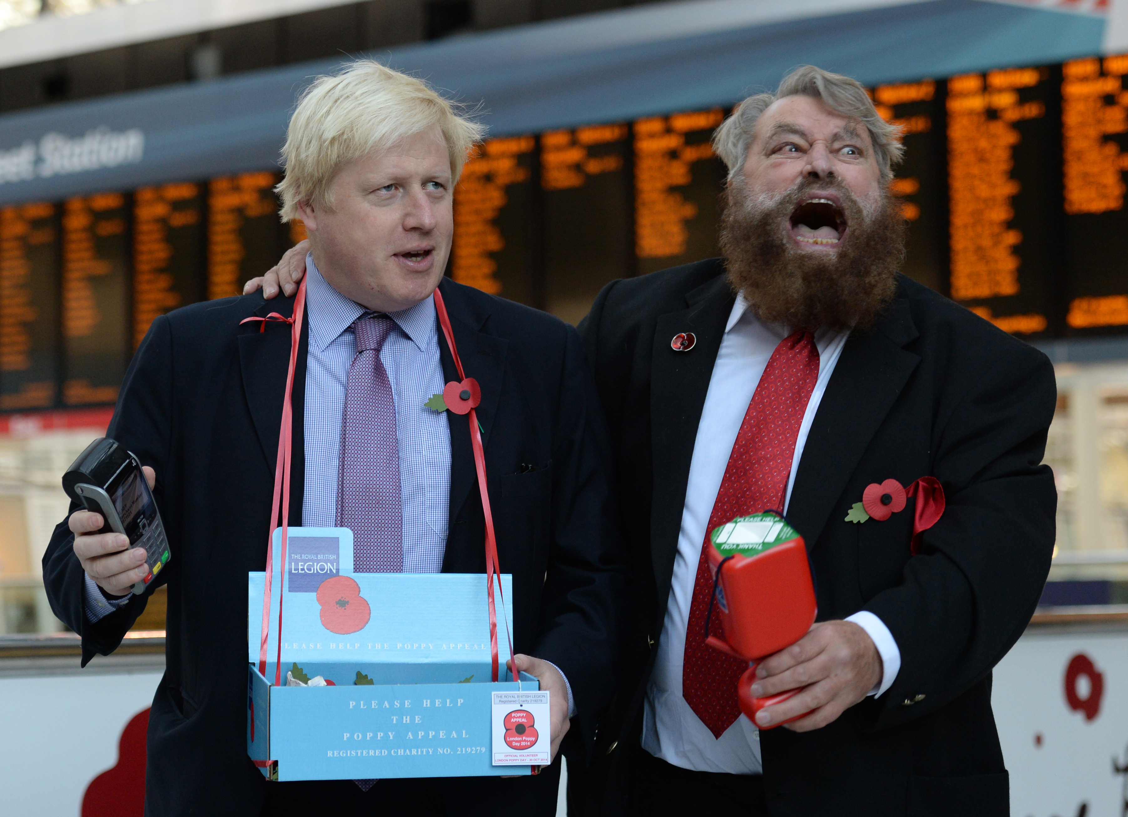 The Mayor of London Boris Johnson (left) and actor Brian Blessed sell poppies in Liverpool Street Station in central London.