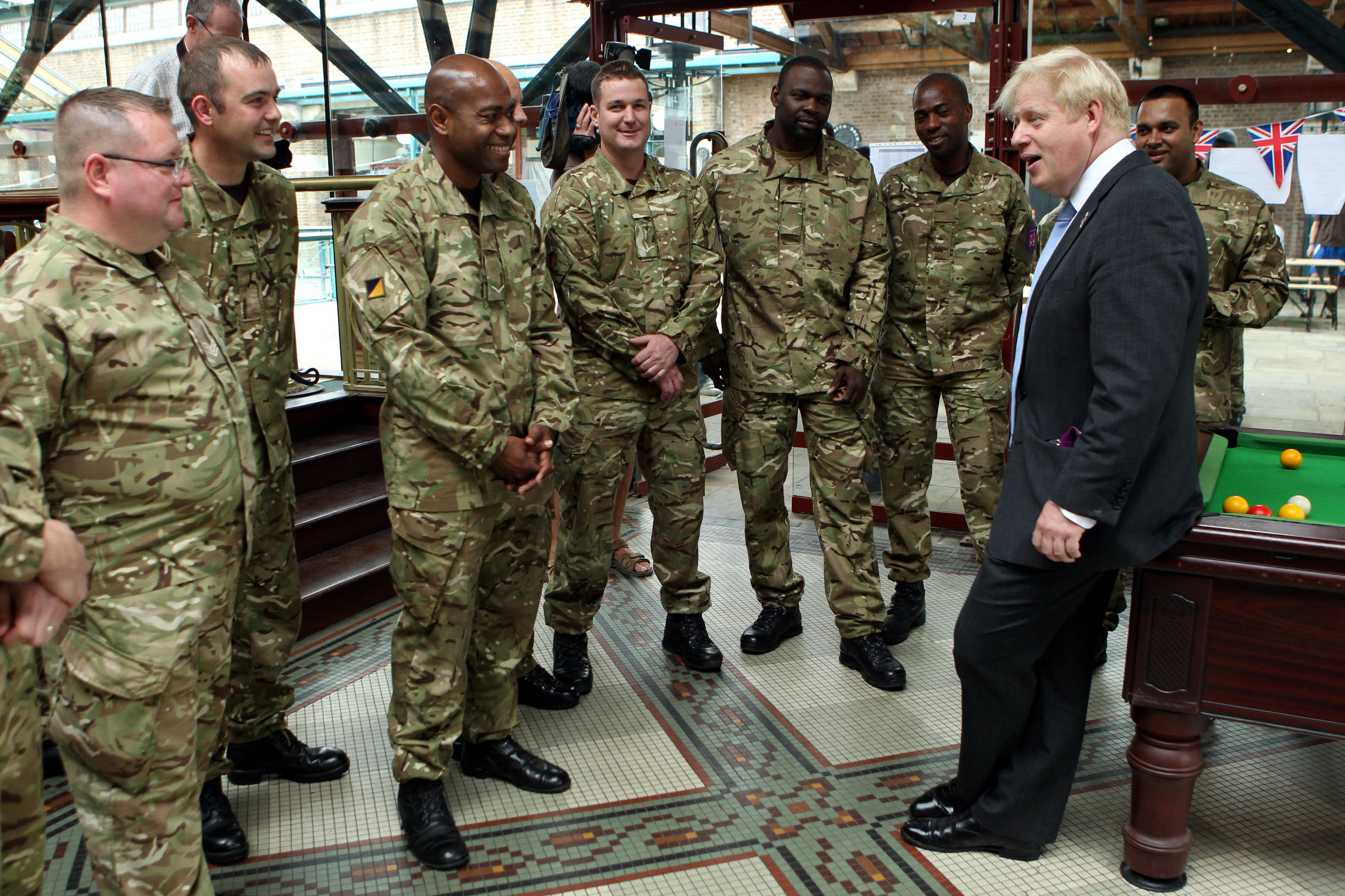 London Mayor Boris Johnson talks to members of the armed forces during a visit to Tobacco Dock, Wapping, as a thank you for their help in making the London 2012 Olympic Games secure.
