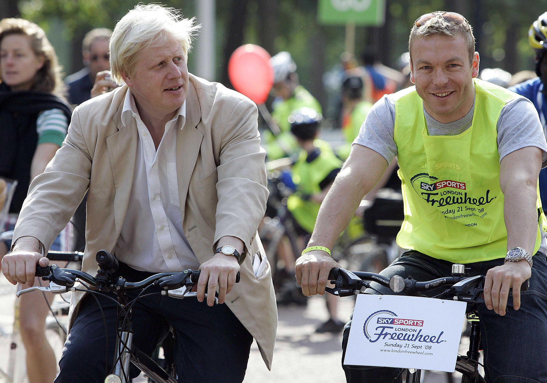 London Mayor Boris Johnson rides next to Olympic gold medallist Chris Hoy (right) during the 2008 London Freewheel event in London.