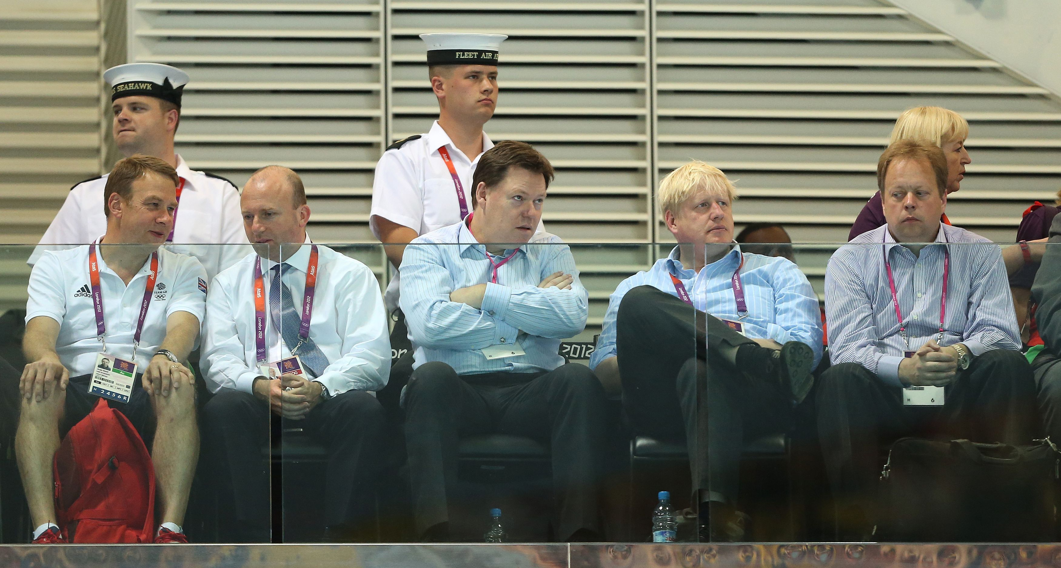 Mayor of London Boris Johnson (second right) watches Great Britain's Tom Daley and Peter Waterfield compete in the Men's Synchronised 10m Platform competition at the Aquatics Centre in the Olympics Park during the third day of the London 2012 Olympics.
