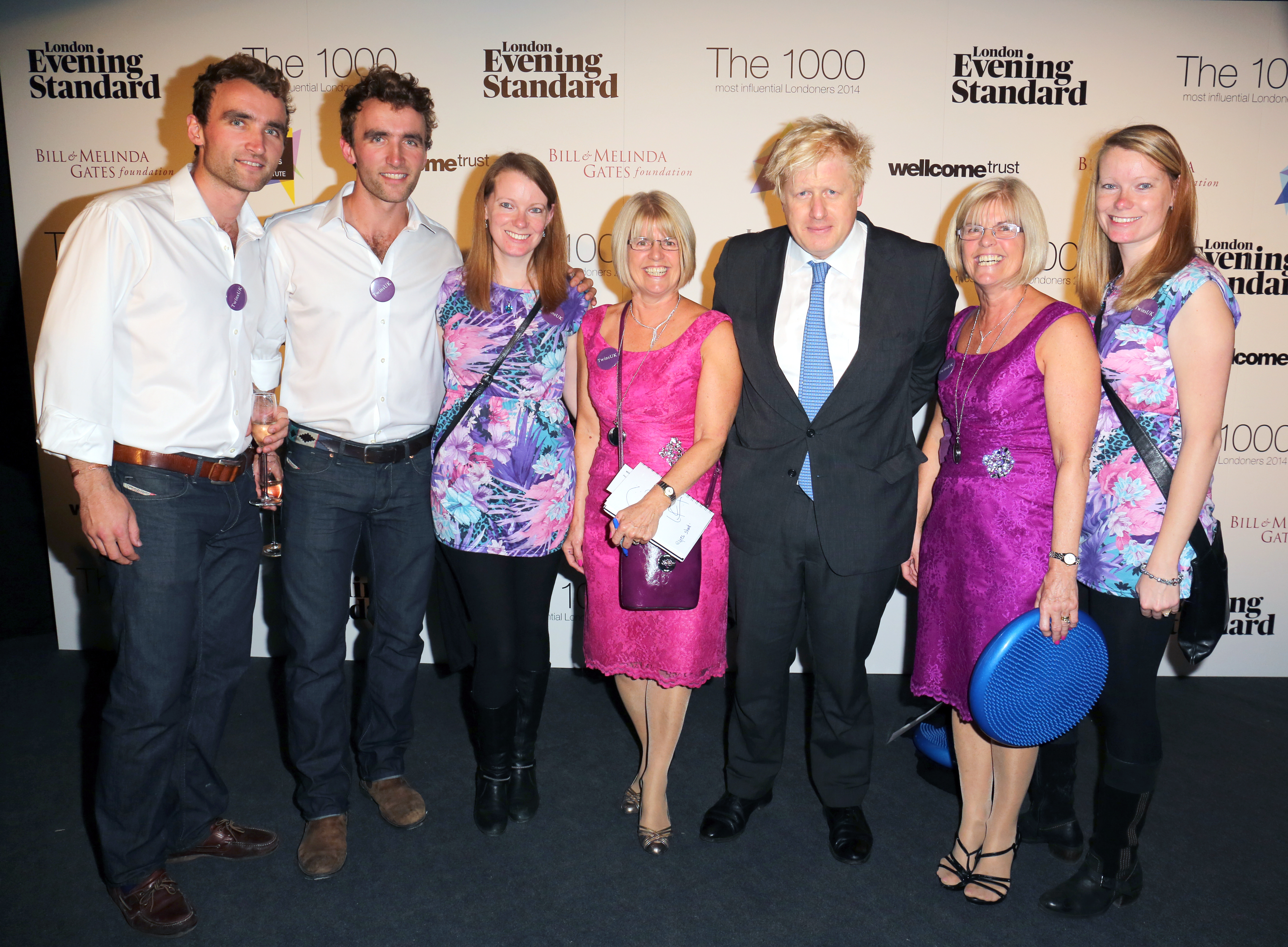 Mayor of London Boris Johnson with identical twins at the Evening Standard's The 1000 Most Influential Londoners 2014, event at The Francis Crick Institute in London.