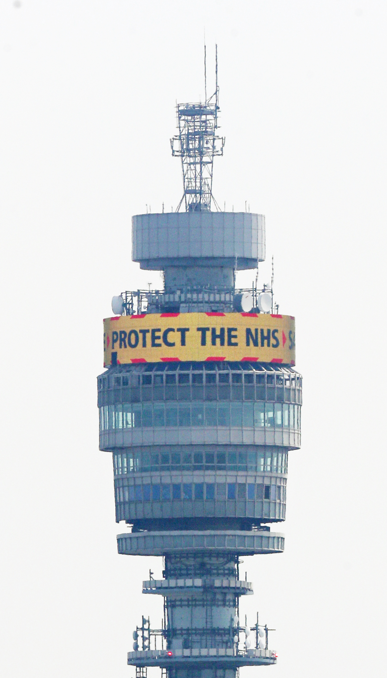 The government's message: 'Stay Home, Protect the NHS, Save Lives' is shown in lights on the rotating display near the top of the BT Tower in the Fitzrovia area of London as the UK continues in lockdown to fight the coronavirus pandemic.