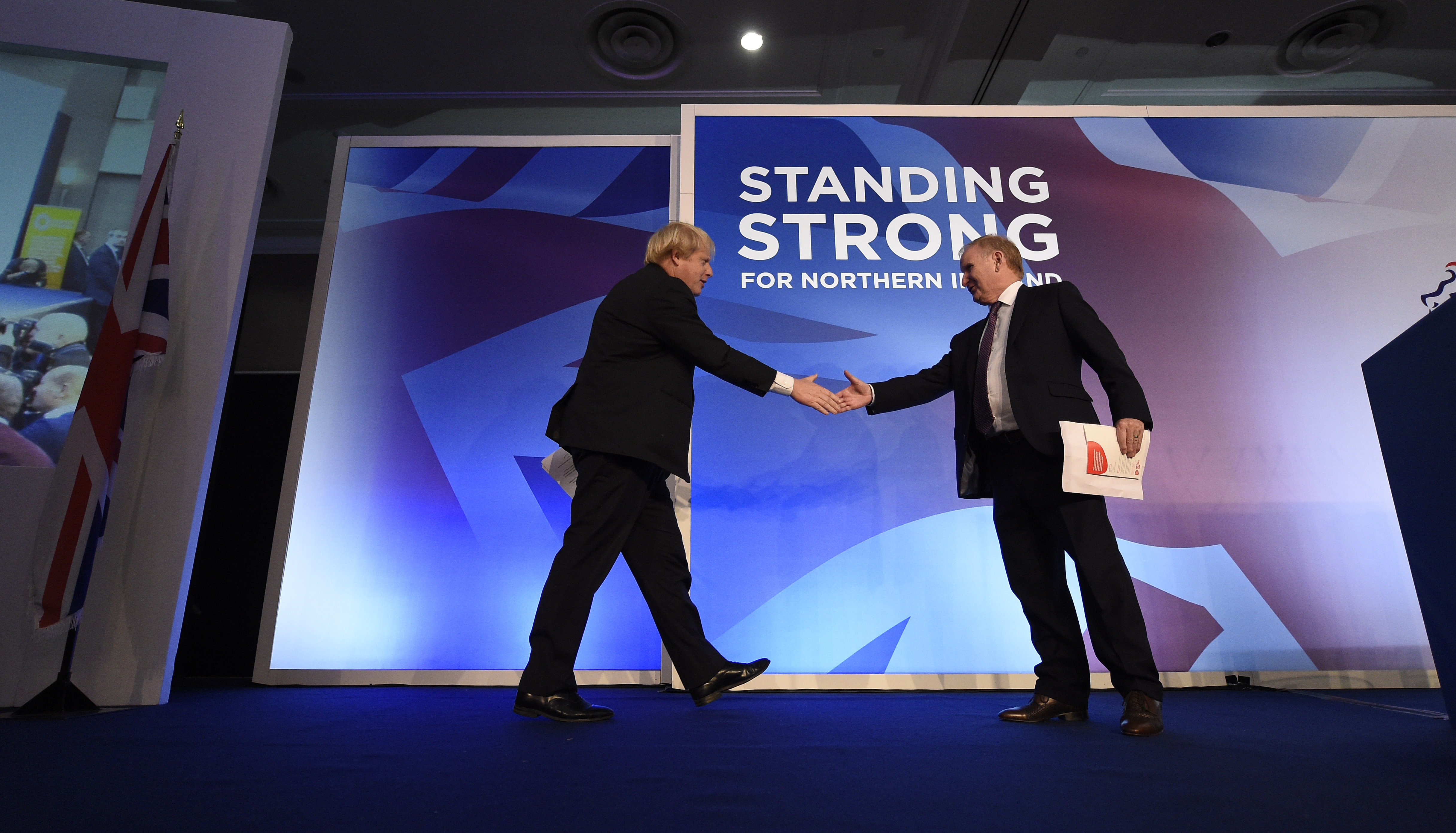 Boris Johnson (left), guest speaker during the DUP annual conference is welcomed onto the stage by Lord Morrow, DUP Chairman at the Crown Plaza Hotel in Belfast.