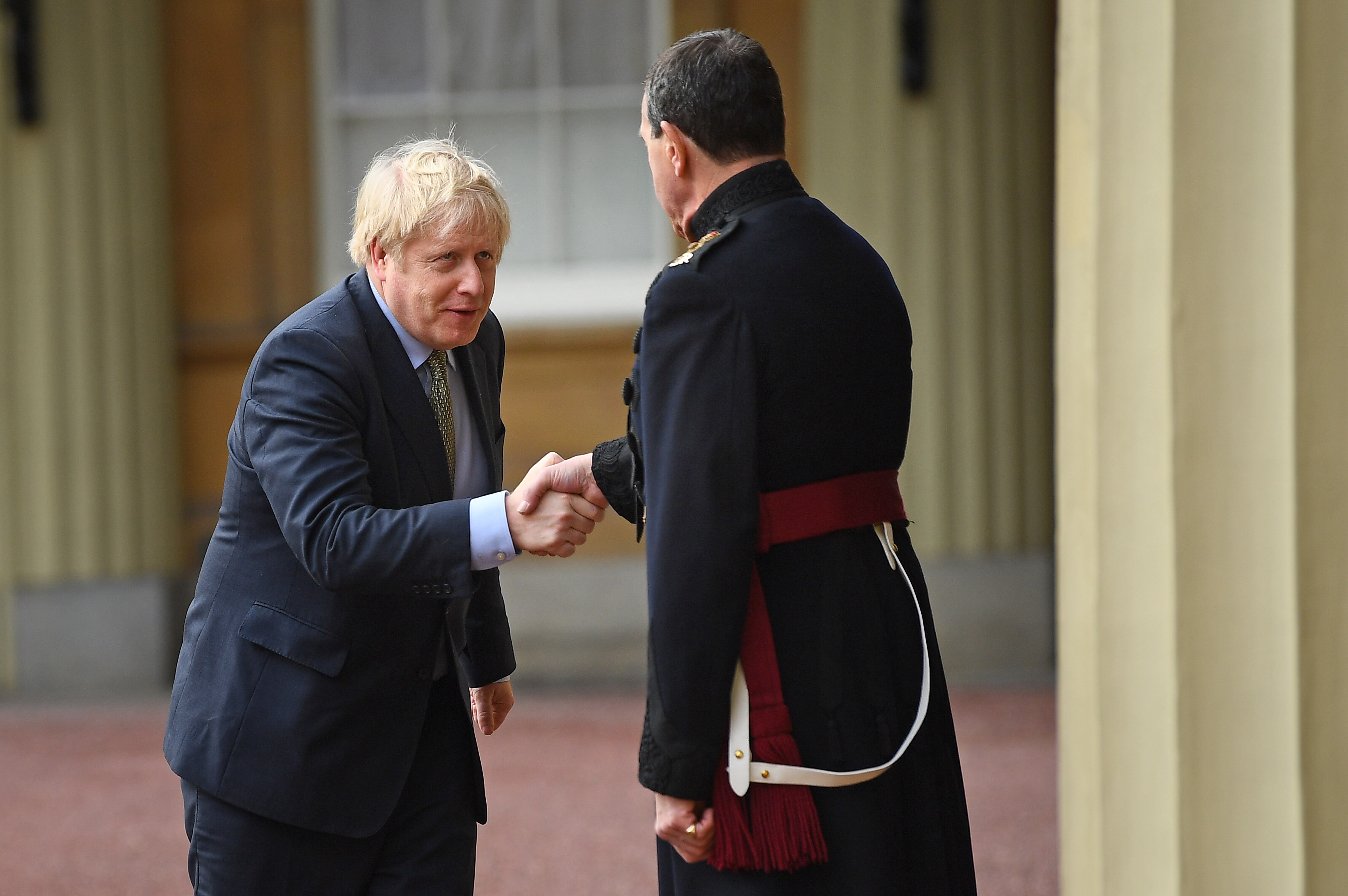 Prime Minister Boris Johnson (left) shakes hands with Queen's Equerry-in-Waiting Lieutenant Colonel Charles Richards as he leaves Buckingham Palace in London after meeting Queen Elizabeth II and accepting her invitation to form a new government after the Conservative Party was returned to power in the General Election with an increased majority.
