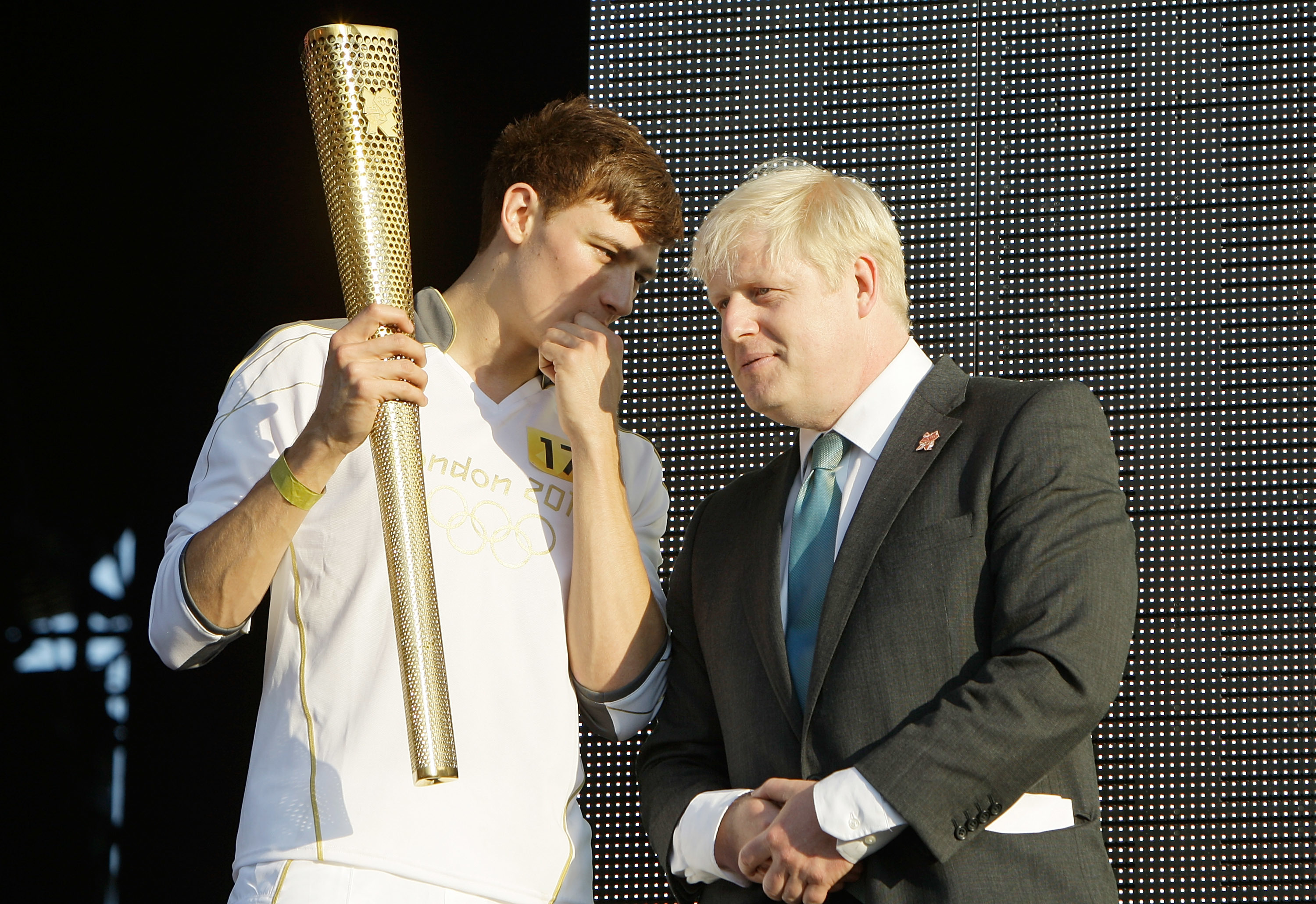 Tyler Rix and Mayor Boris Johnson with the Olympic Torch at Coca-Cola's London 2012 Olympic Torch Relay Concert at Hyde Park in London.