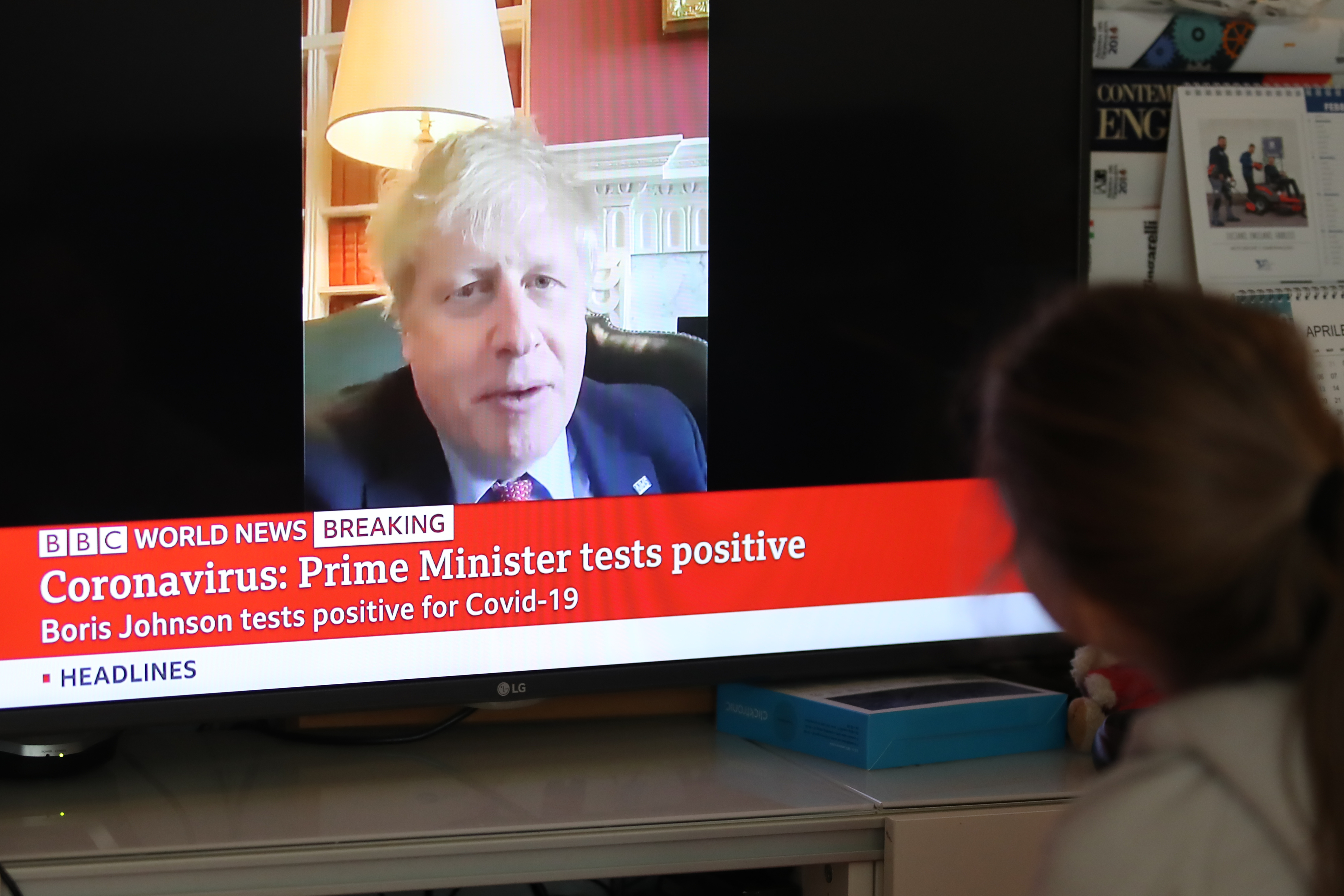 27/03/2020 in Pergine Valsugana, Italy. A girl looks at BBC World News giving the Breaking News of UK Prime Minister Boris Johnson tested positive at the Coronavirus Most part of Europe is today on a sweeping confinement to try to slow down the spread of the Covid-19 Pandemic. Boris Johnson, UK Prime Minister. (Photo by ESPA/Cal Sport Media/Sipa USA)