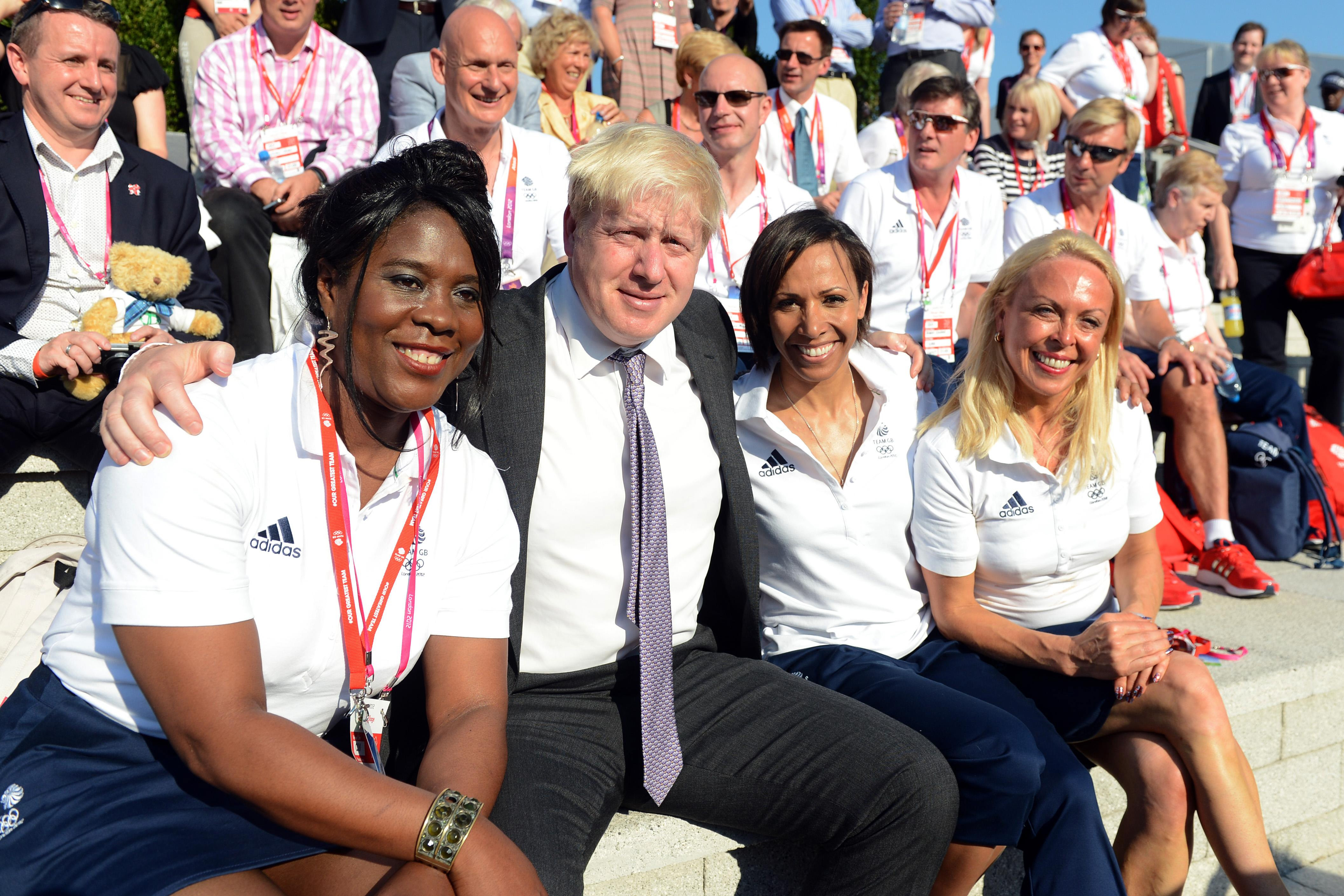 London Mayor Boris Johnson poses with Tessa Sanderson (left), Dame Kelly Holmes and Jayne Torvill (right) during the Welcome Ceremony at the Athletes Village, Olympic Park, London.