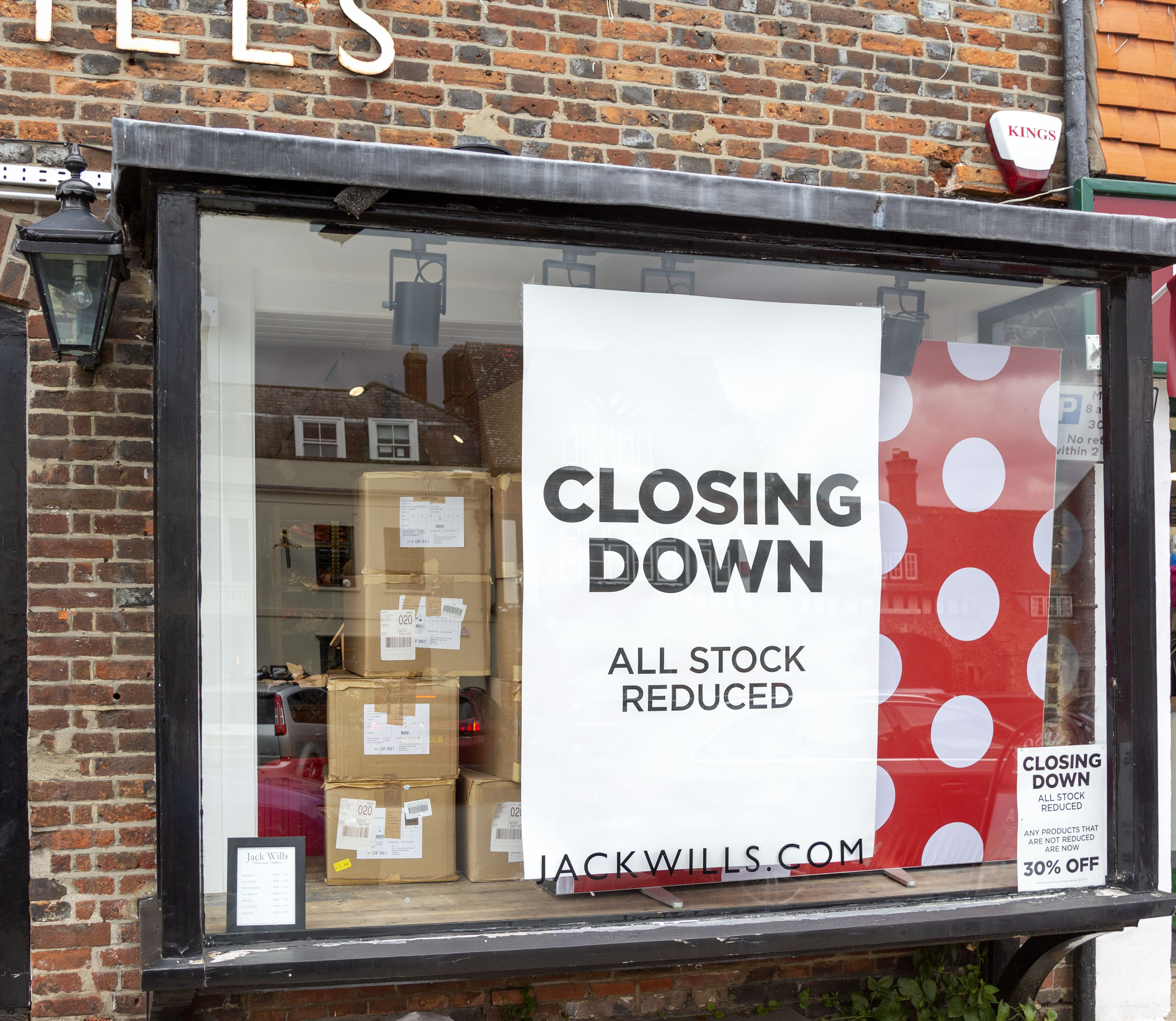 Closing down banner sign shop window, Jack Wills store, Marlborough, Wiltshire, England, UK. (Photo by: Geography Photos/Universal Images Group via Getty Images)