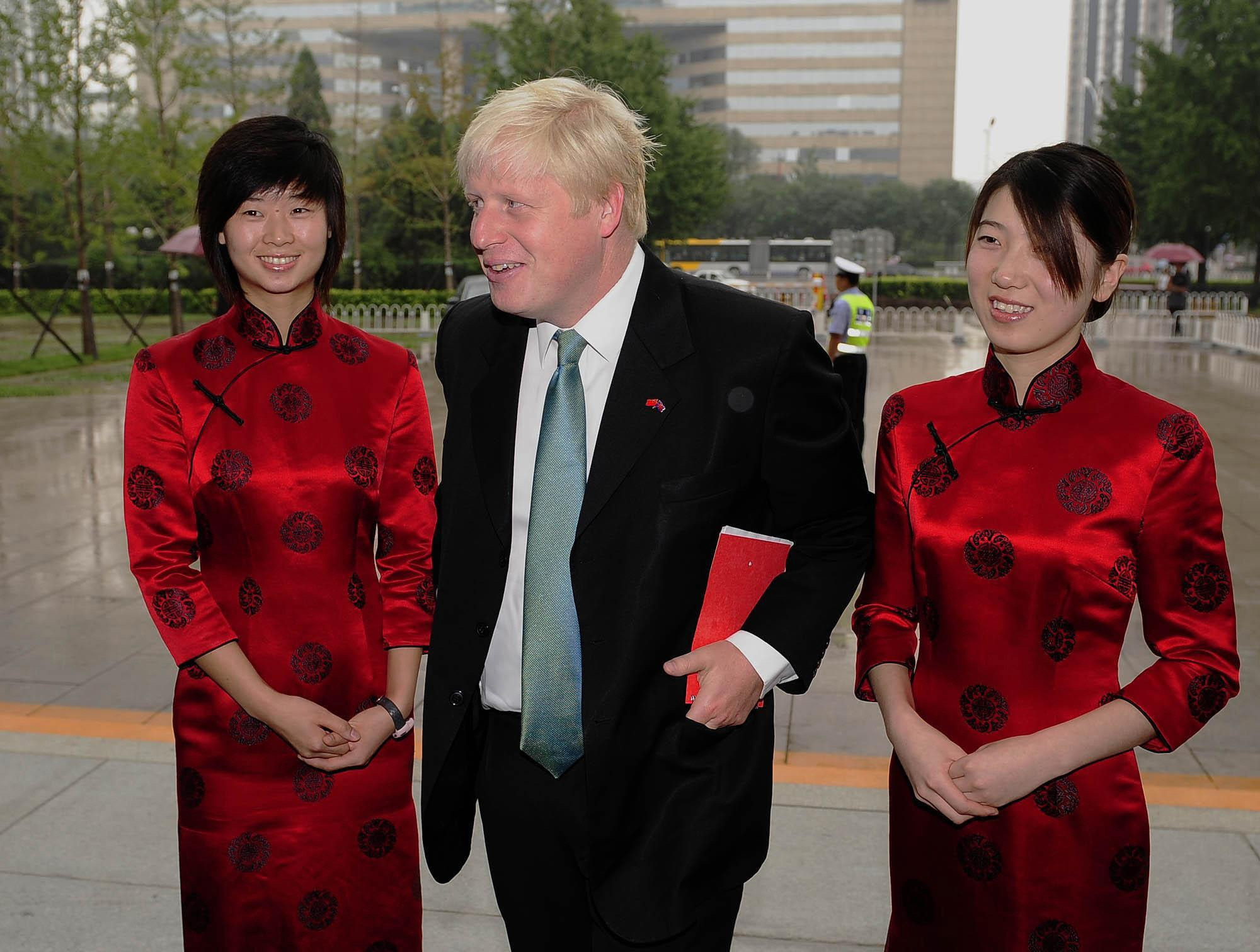 RETRANSMISSION: CAPTION CORRECTION: making clear he is arriving for meeting. Mayor of London Boris Johnson arrives at the Beijing International Hotel Conference Centre to meet the Mayor of Beijing Guo Jiniong ahead of the London Handover at the Closing Ceremony on Sunday of the 2008 Olympic Games in China.
