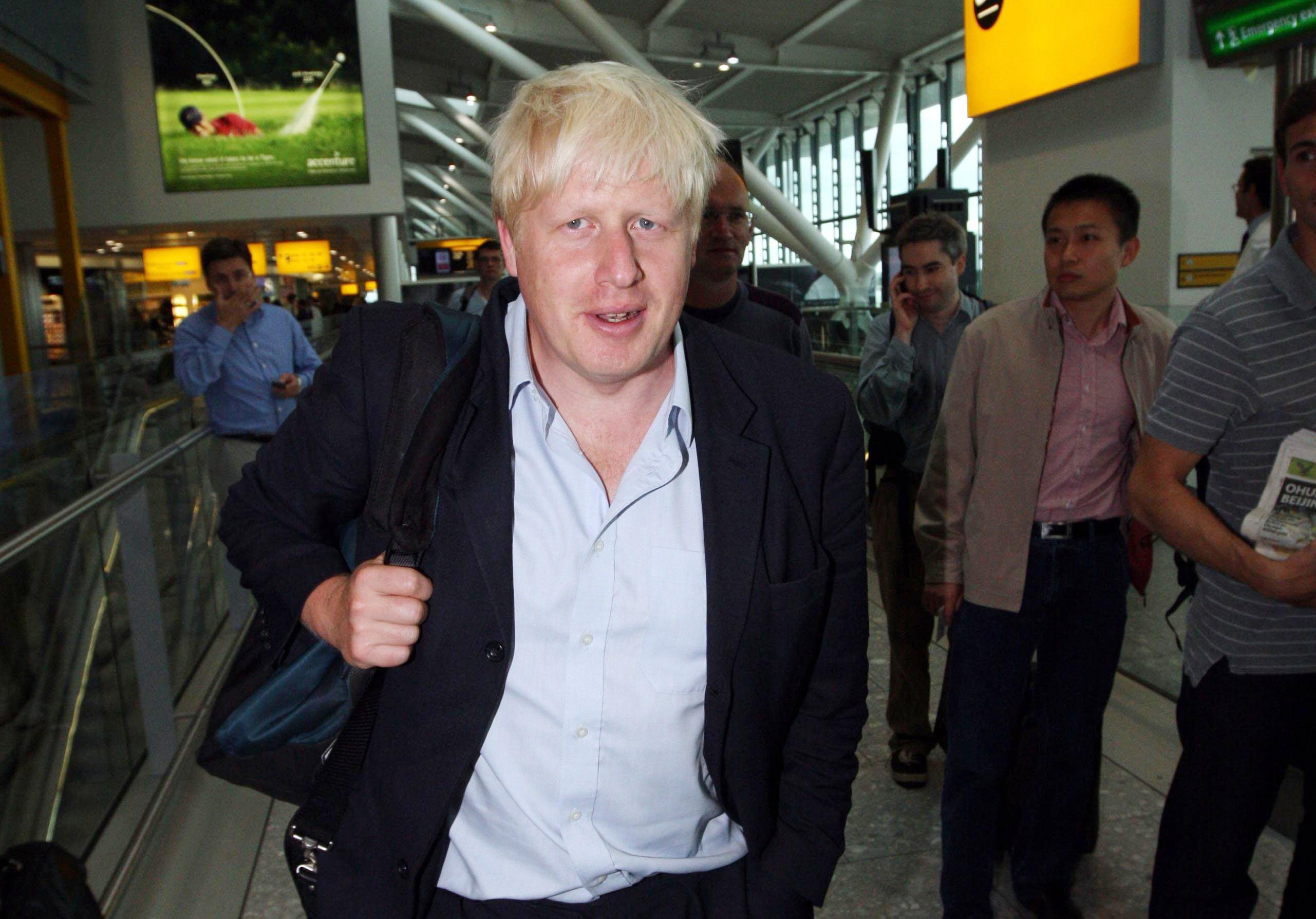 London Mayor Boris Johnson leaves Heathrow Airport's Terminal 5 heading to Beijing for the closing ceremony of the 2008 Olympic games where the flag is then passed on to London.