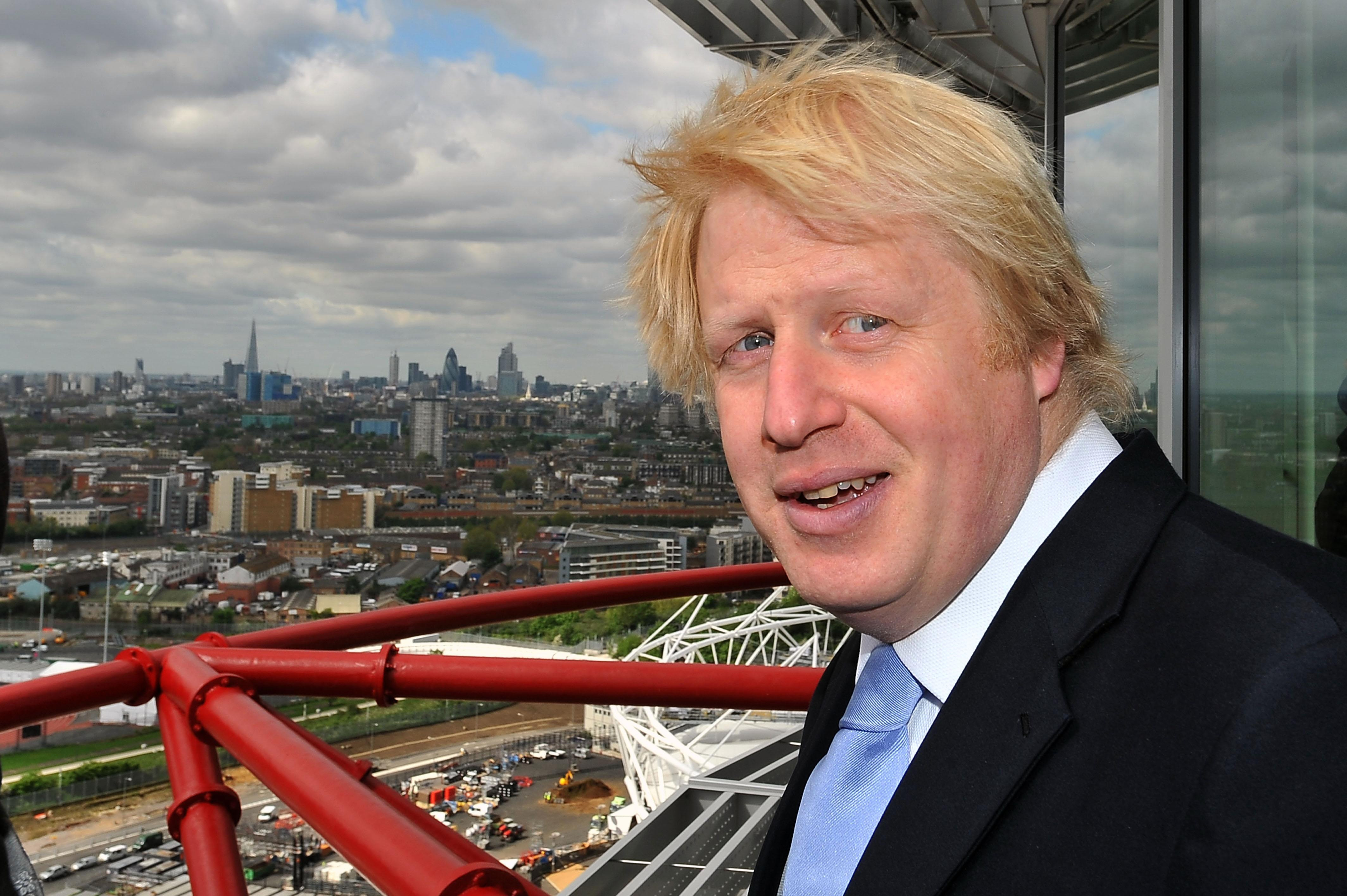 London Mayor Boris Johnson looks out from the public viewing platform of the newly completed ArcelorMittal Orbit, the Anish Kapoor and Cecil Balmond-designed sculpture that that will stand at the heart of the London 2012 Olympic and Paralympic Park.