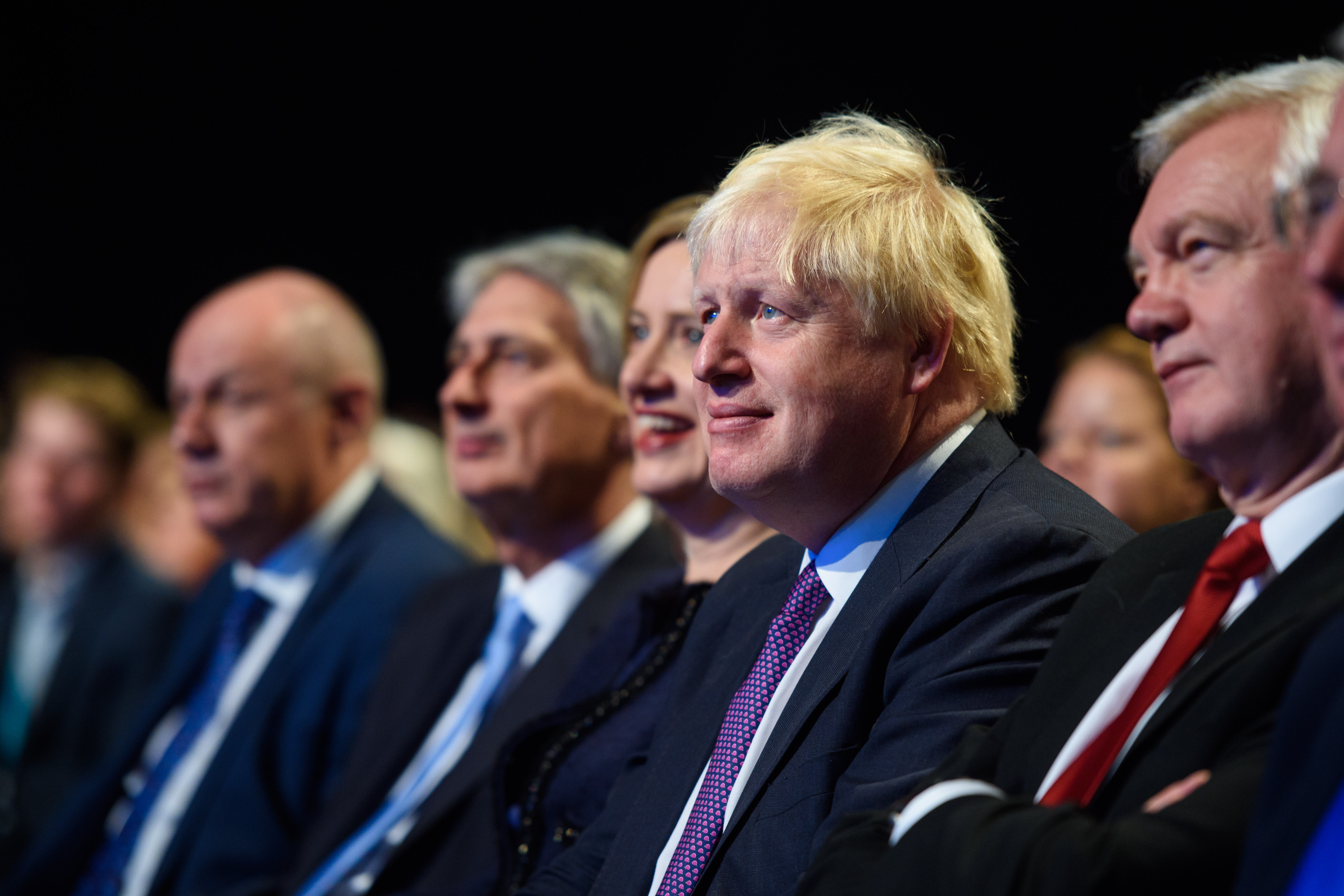 Foreign Minister Boris Johnson watches as Prime Minister Theresa May speaks at the Conservative Party Conference, at the Manchester Central Convention Complex in Manchester. Picture date: 4 October, 2017. Photo credit should read: Matt Crossick/ EMPICS Entertainment.