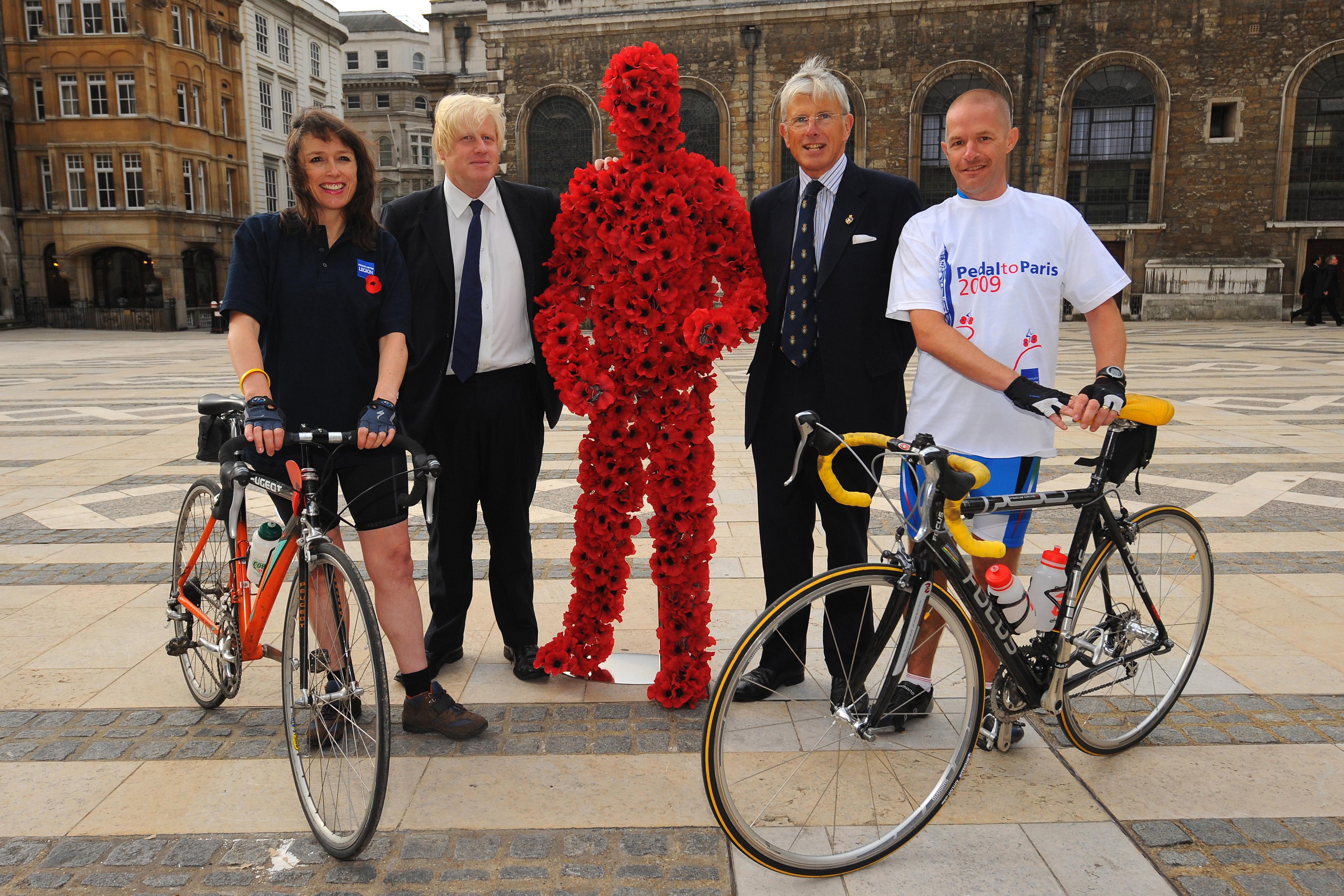 The Mayor of London, Boris Johnson celebrates the start of the Royal British Legion's Pedal to Paris ride 2009 in London.