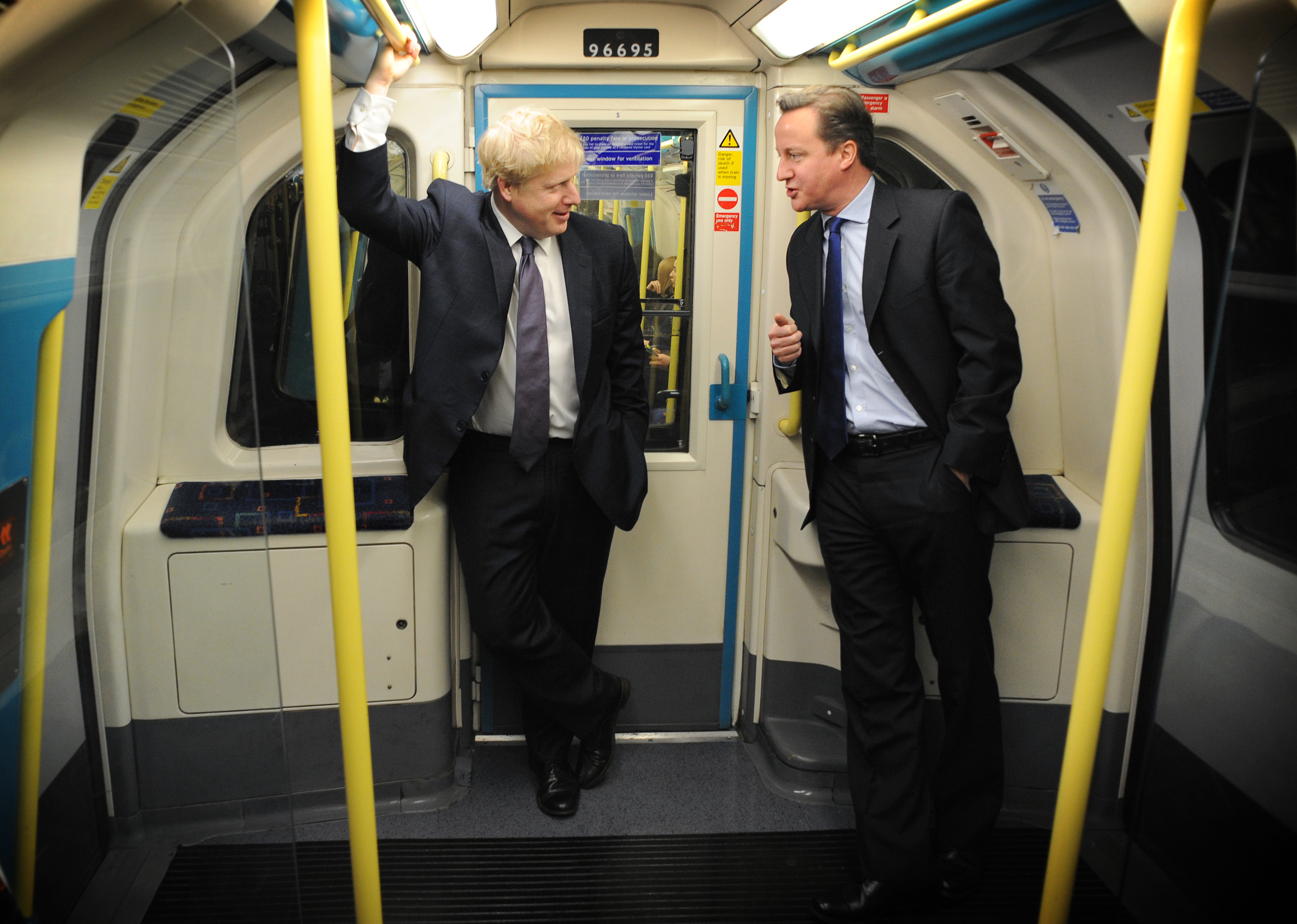 Prime Minister David Cameron and London Mayor Boris Johnson (left) take the tube from Westminster to Southwark where they visited Transport for London's Surface Transport and Traffic Operations Centre which monitors traffic flow and will play a key part in the summer during the London Olympics. PRESS ASSOCIATION Photo. Picture date: Saturday March 3, 2012. See PA story POLITICS Conservatives. Photo credit should read: Stefan Rousseau/PA Wire