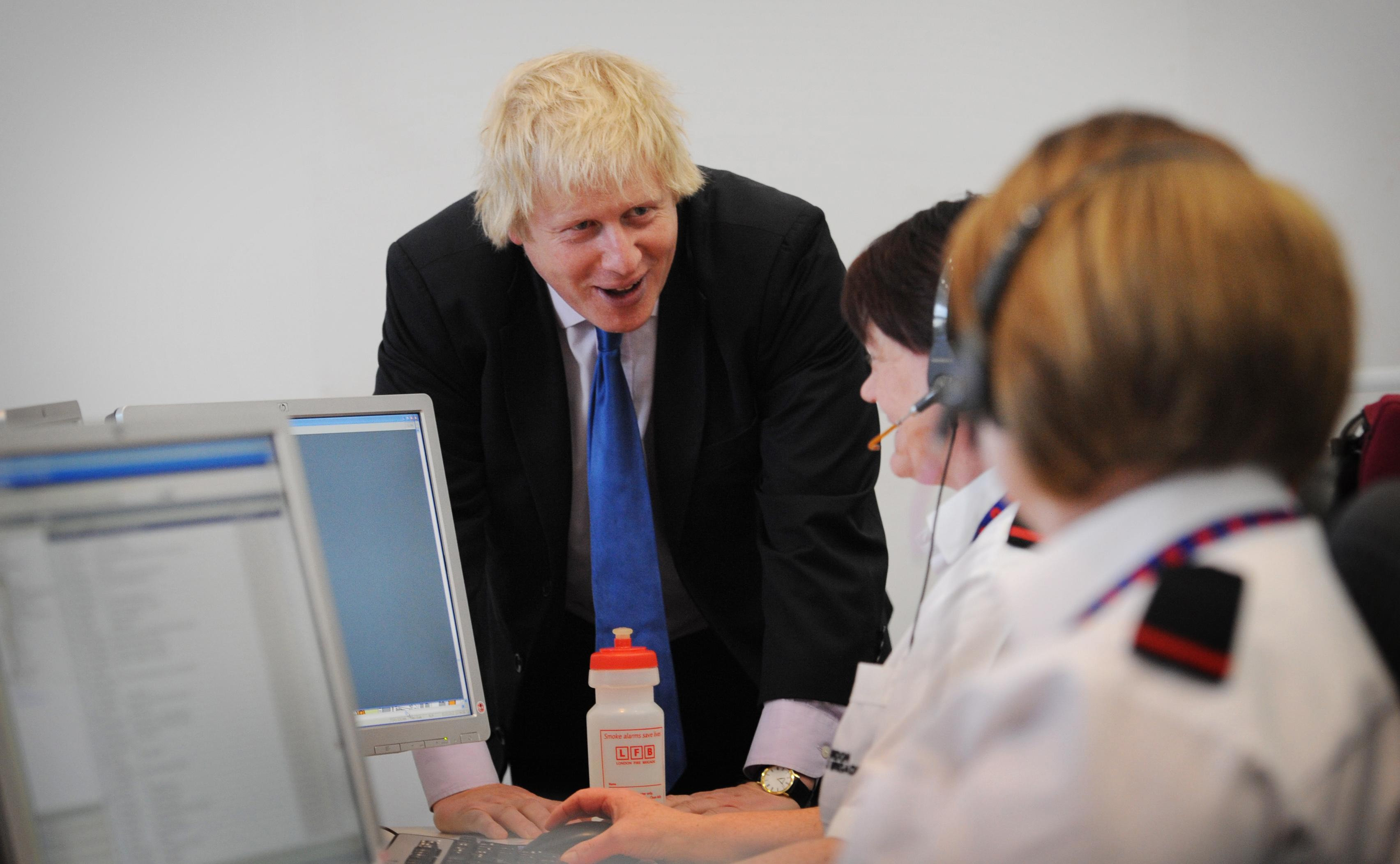 London Mayor Boris Johnson tours the new fire control centre in west London ahead of the London 2012 Olympic Games later this year after it was officially opened.