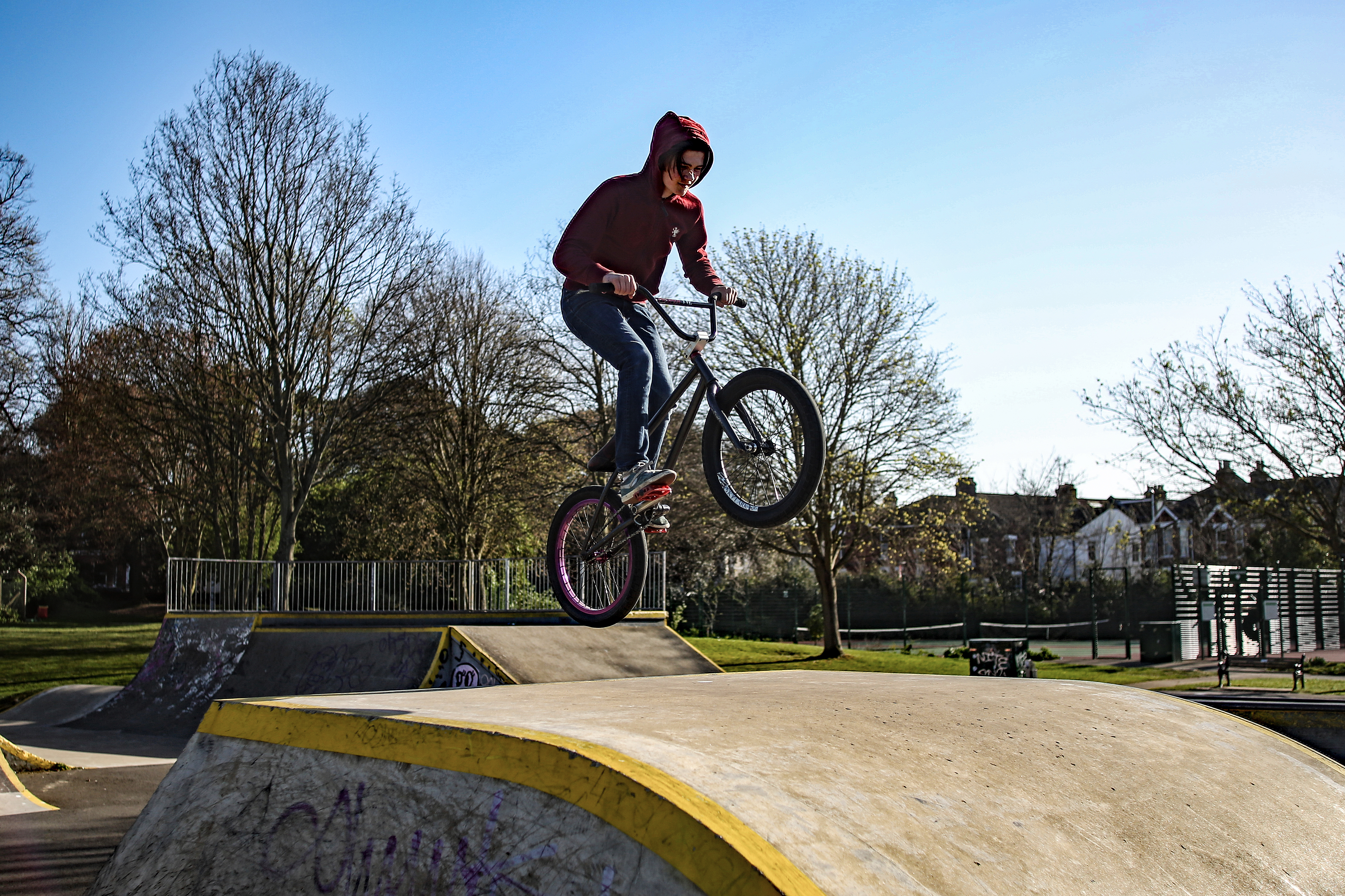A boy on his BMX rides up a ramp as he gets his daily exercise in a skatepark while the UK continues in lockdown to help curb the spread of the coronavirus.