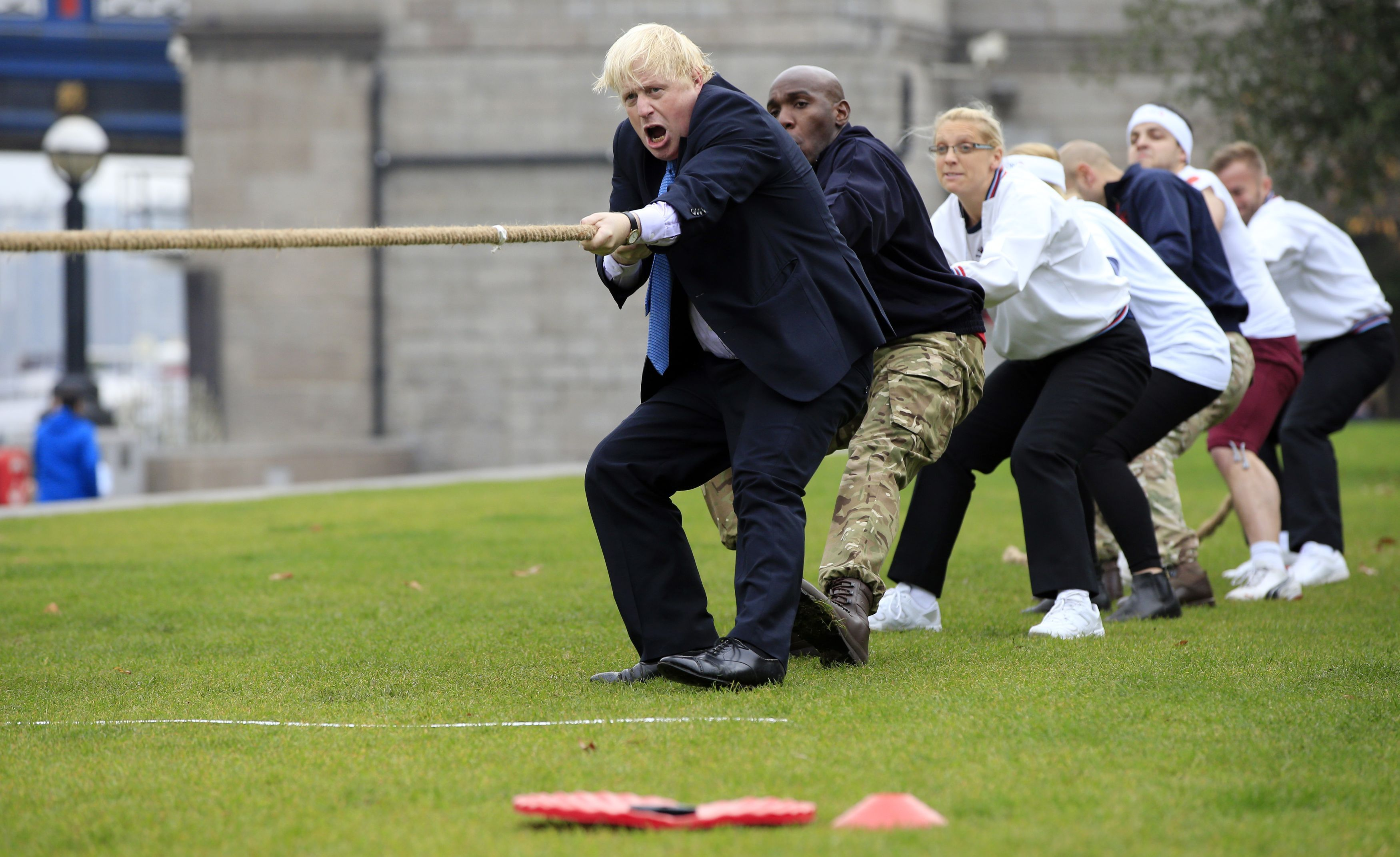 Mayor of London Boris Johnson (left) takes part in a tug of war with personnel from the Royal Navy, the Army and the Royal Air Force at the launch of London Poppy Day, on Potters Field, next to City Hall in London.