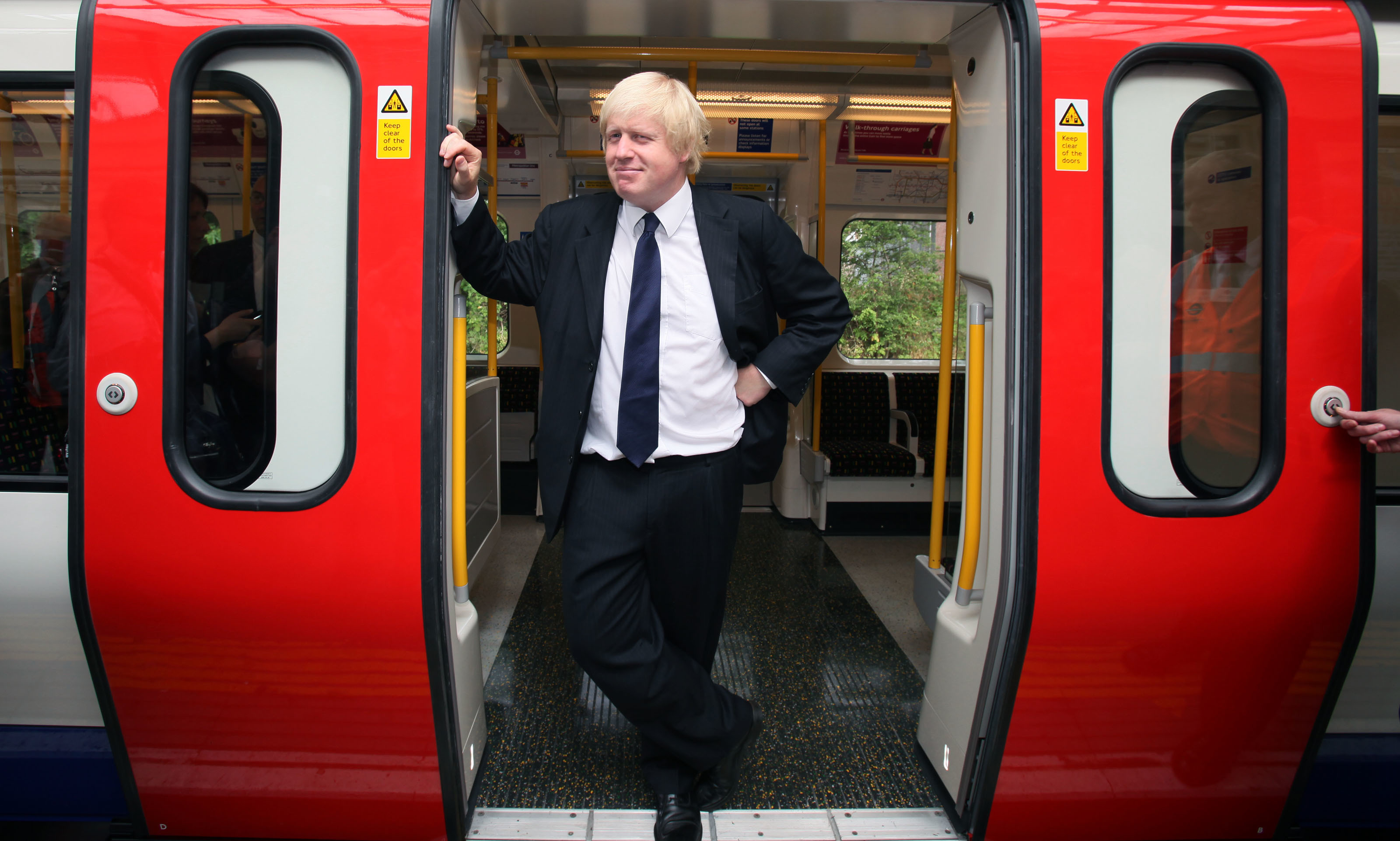 London Mayor Boris Johnson stands in the door of the first new air-conditioned train in London as part of a scheme to have 40\% of tube trains air-conditioned by 2015. PRESS ASSOCIATION Photo. Picture date: Monday August 02, 2010. The train serving the Metropolitan Line is the first of 191 brand new walk-through trains. See PA story TRANSPORT Air. Photo credit should read: Katie Collins/PA Wire
