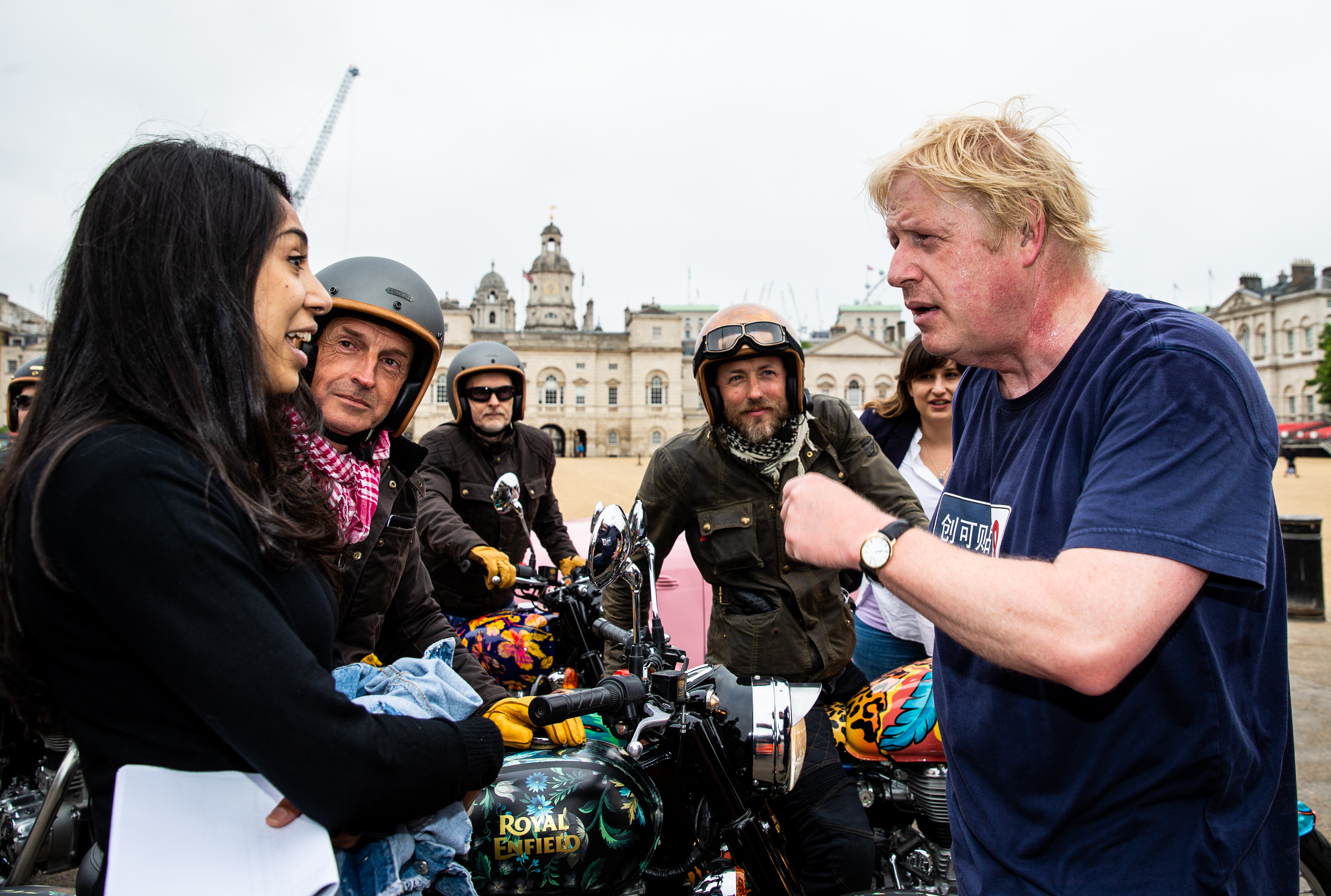 Boris Johnson, Secretary of State for Foreign Affairs chats to Simon de Burton on the House of Hackney bike and Sam Pelly on the Boyarde bike while on Elephant Family's 'Concours d'éléphant' outside Horse Guards during the photocall in London. PRESS ASSOCIATION Photo. Picture date: Tuesday June 12, 2018. A customised fleet of 12 Ambassador cars, eight Royal Enfield motorbikes, a tuk tuk and a Gujarati Chagda made up the 'Concours d'éléphant' - a cavalcade of designer inspired, quintessentially Indian vehicles - while thirty beautifully decorated elephant sculptures will stand sentinel across the capital, ambassadors for their cousins in the wild. Boris Johnson, Secretary of State for Foreign Affairs chats to Simon de Burton on the House of Hackney bike and Sam Pelly on the Boyarde bike while on Elephant Family's 'Concours d'éléphant' outside Horse Guards during the photocall in London. PRESS ASSOCIATION Photo. Picture date: Tuesday June 12, 2018. A customised fleet of 12 Ambassador cars, eight Royal Enfield motorbikes, a tuk tuk and a Gujarati Chagda made up the 'Concours d'éléphant' - a cavalcade of designer inspired, quintessentially Indian vehicles - while thirty beautifully decorated elephant sculptures will stand sentinel across the capital, ambassadors for their cousins in the wild.