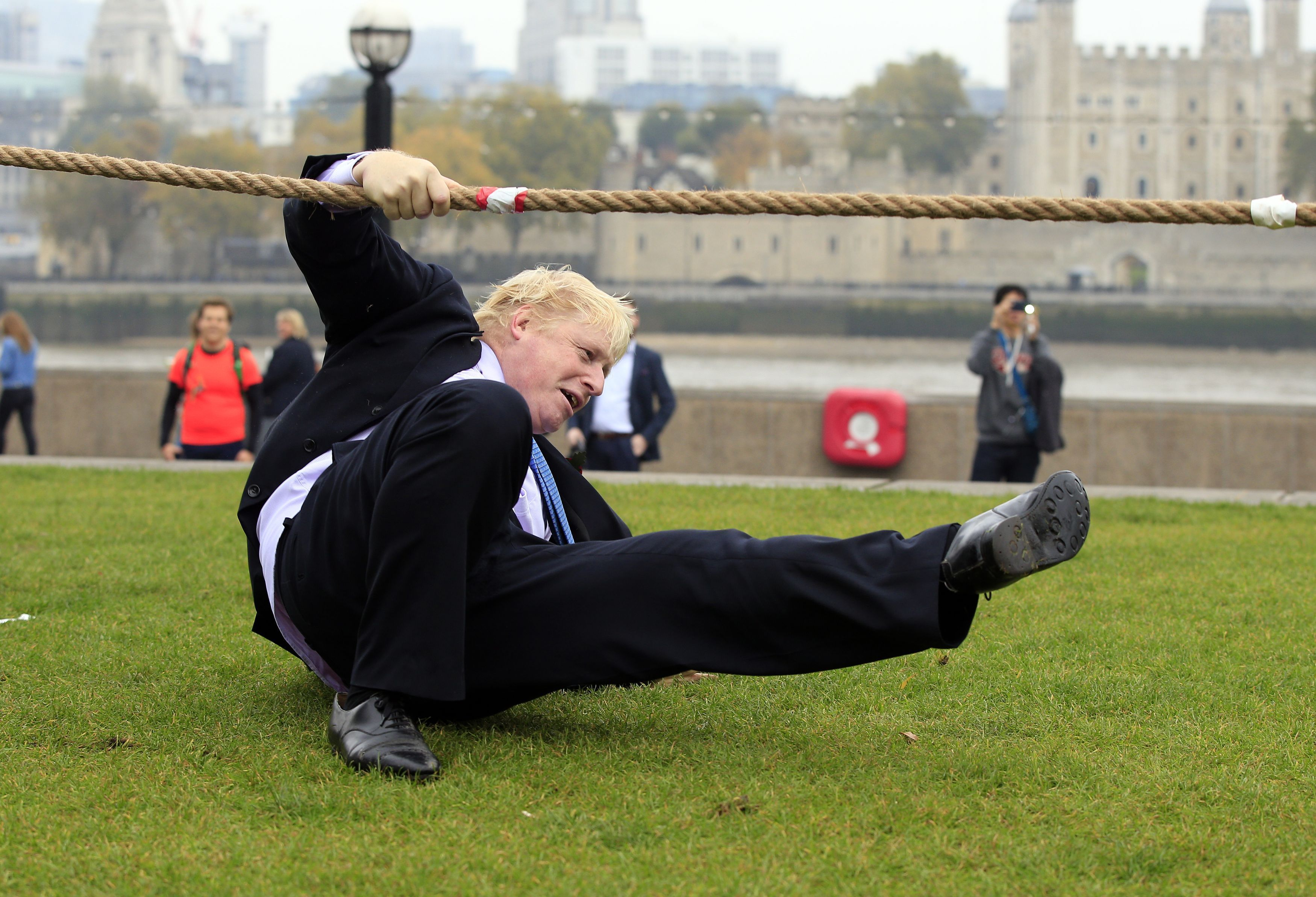 Mayor of London Boris Johnson falls over during a tug of war with personnel from the Royal Navy, the Army and the Royal Air Force at the launch of London Poppy Day, on Potters Field, next to City Hall in London.