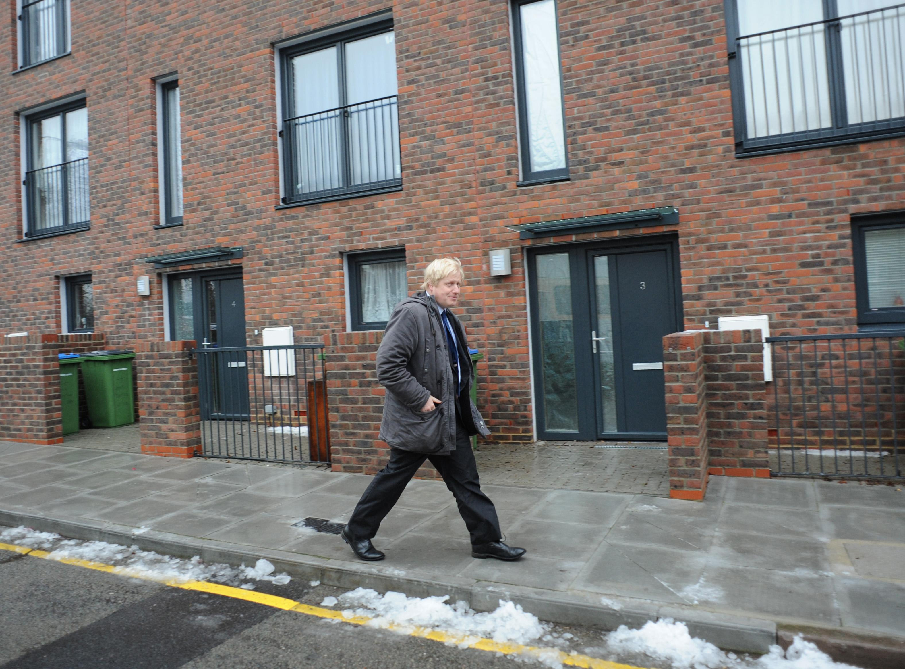 Mayor of London Boris Johnson arrives at the Gallons Close development in Charlton, south east London, where he saw some of the new affordable houses and announced that 50,000 homes would be made available to Londoners by 2012.