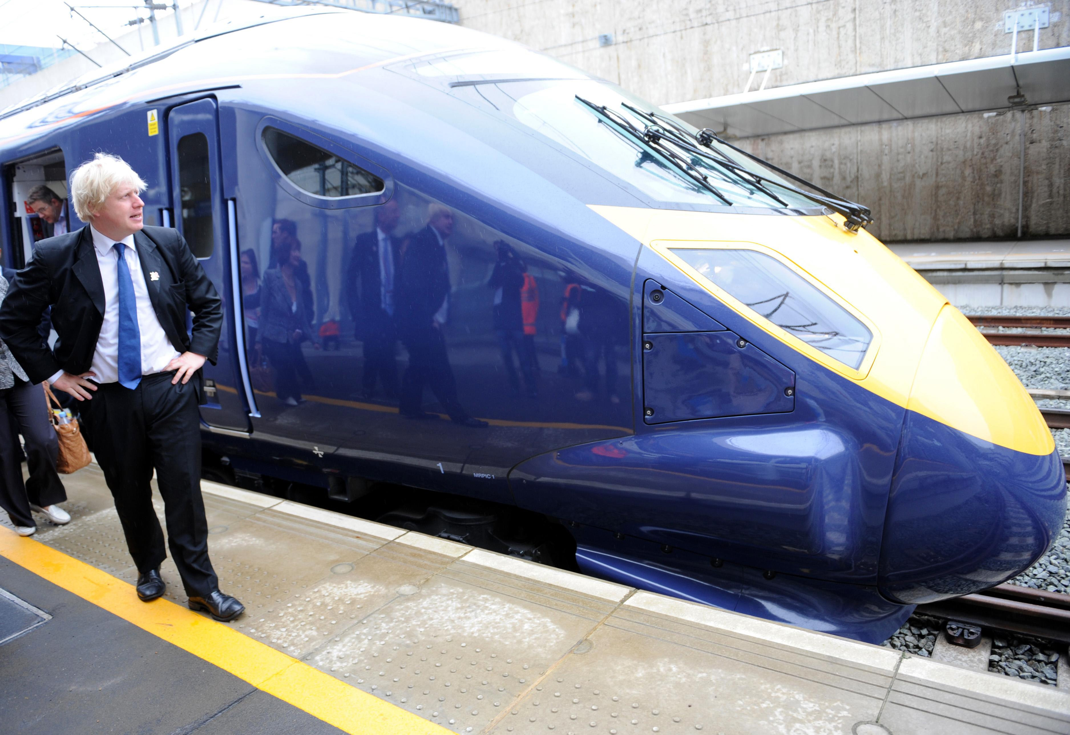 London Mayor Boris Johnson arrives on the high speed Javelin train at Stratford Station where he will view ongoing construction work at the Olympic stadium in east London.
