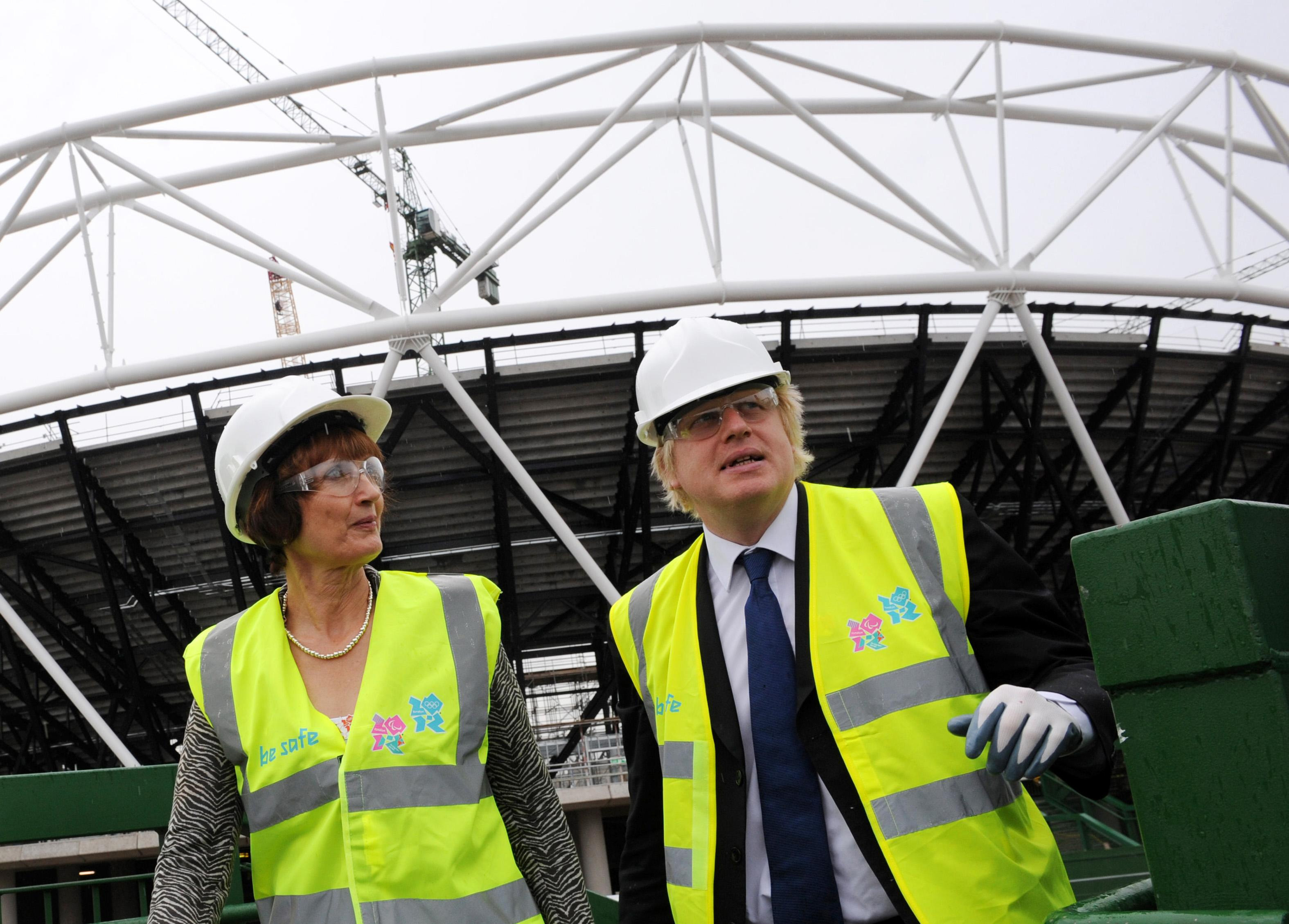 London Mayor Boris Johnson and Olympics Minister Tessa Jowell arrive in Stratford to view ongoing construction work at the Olympic stadium in east London.