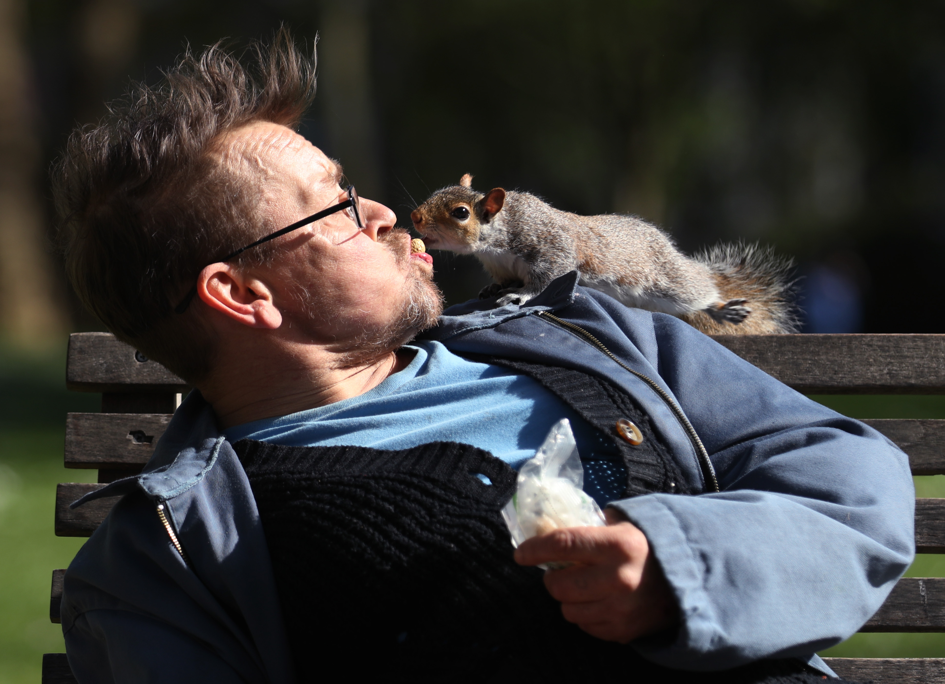 Bobby (no surname given) feeding a peanut to a squirrel in St James's Park, London, as the UK continues in lockdown to help curb the spread of the coronavirus.