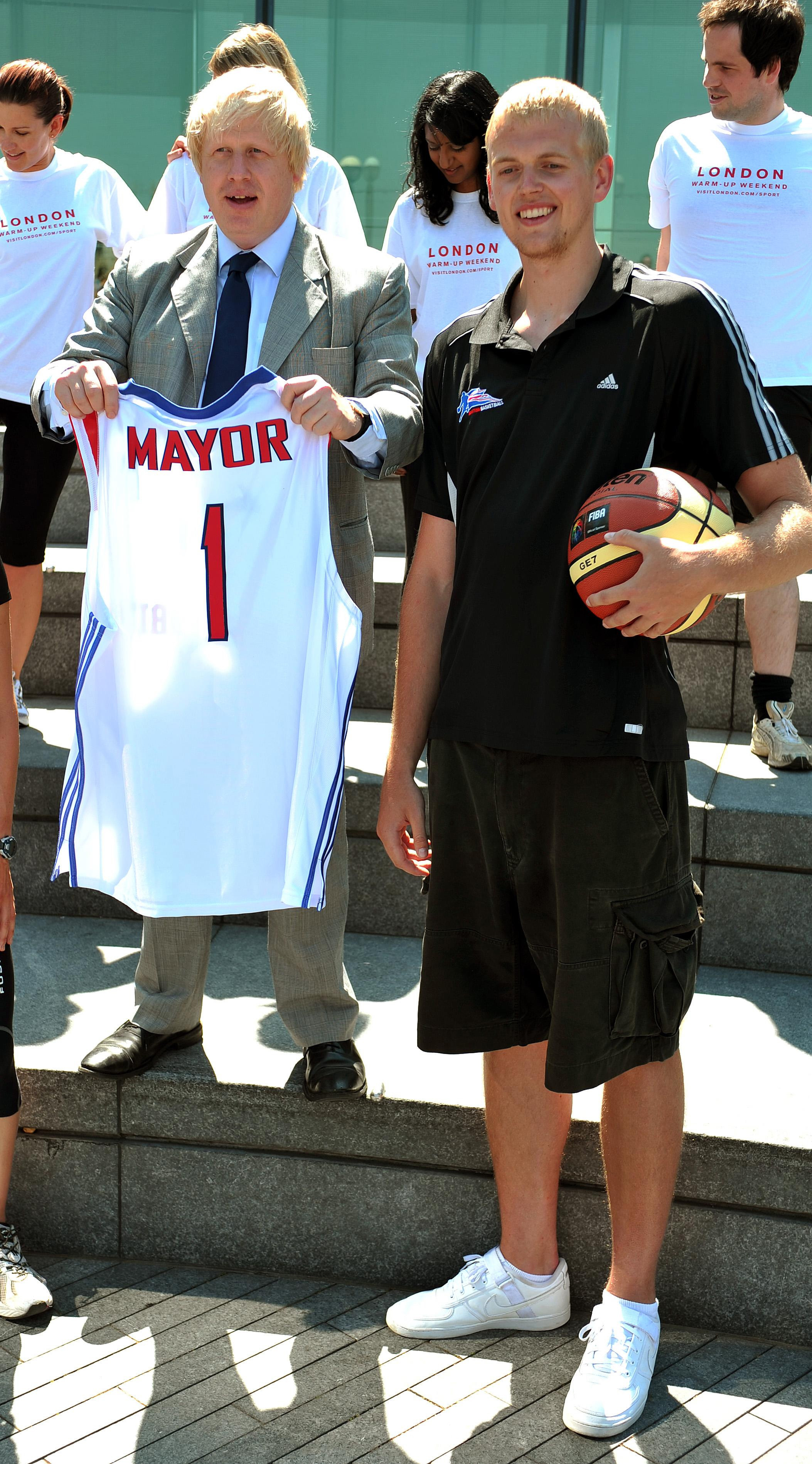 The Mayor of London Boris Johnson stands with basketball player Daniel Clark, during a photocall to promote 'warm up weekend', to get Londoners in the mood for the 2012 London Olympics, outside City hall in central London, this afternoon.