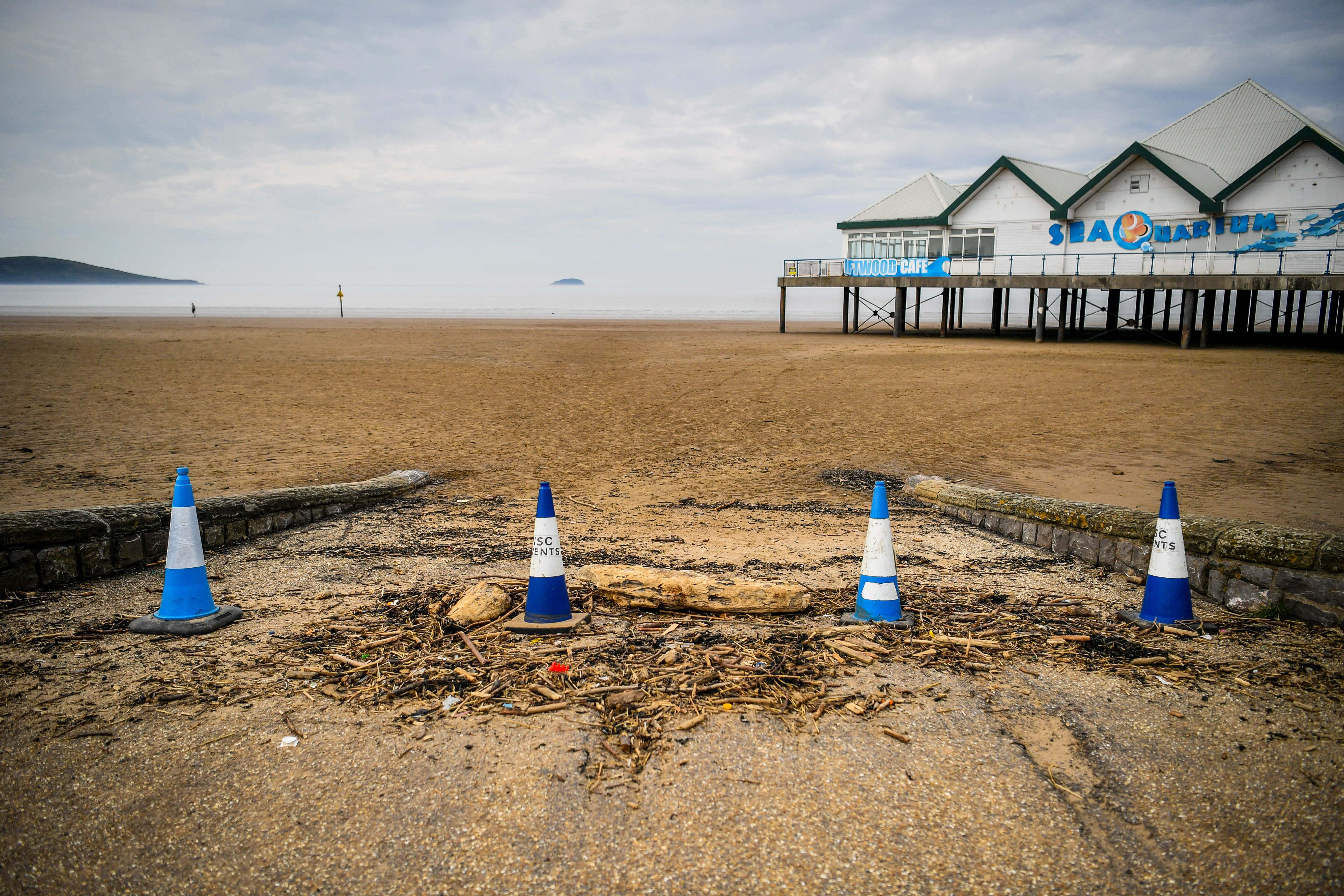 Cones and beach detritus block the entrance to a car parking section of beach around midday on Easter Sunday at Weston-super-Mare as the UK continues in lockdown to help curb the spread of the coronavirus.