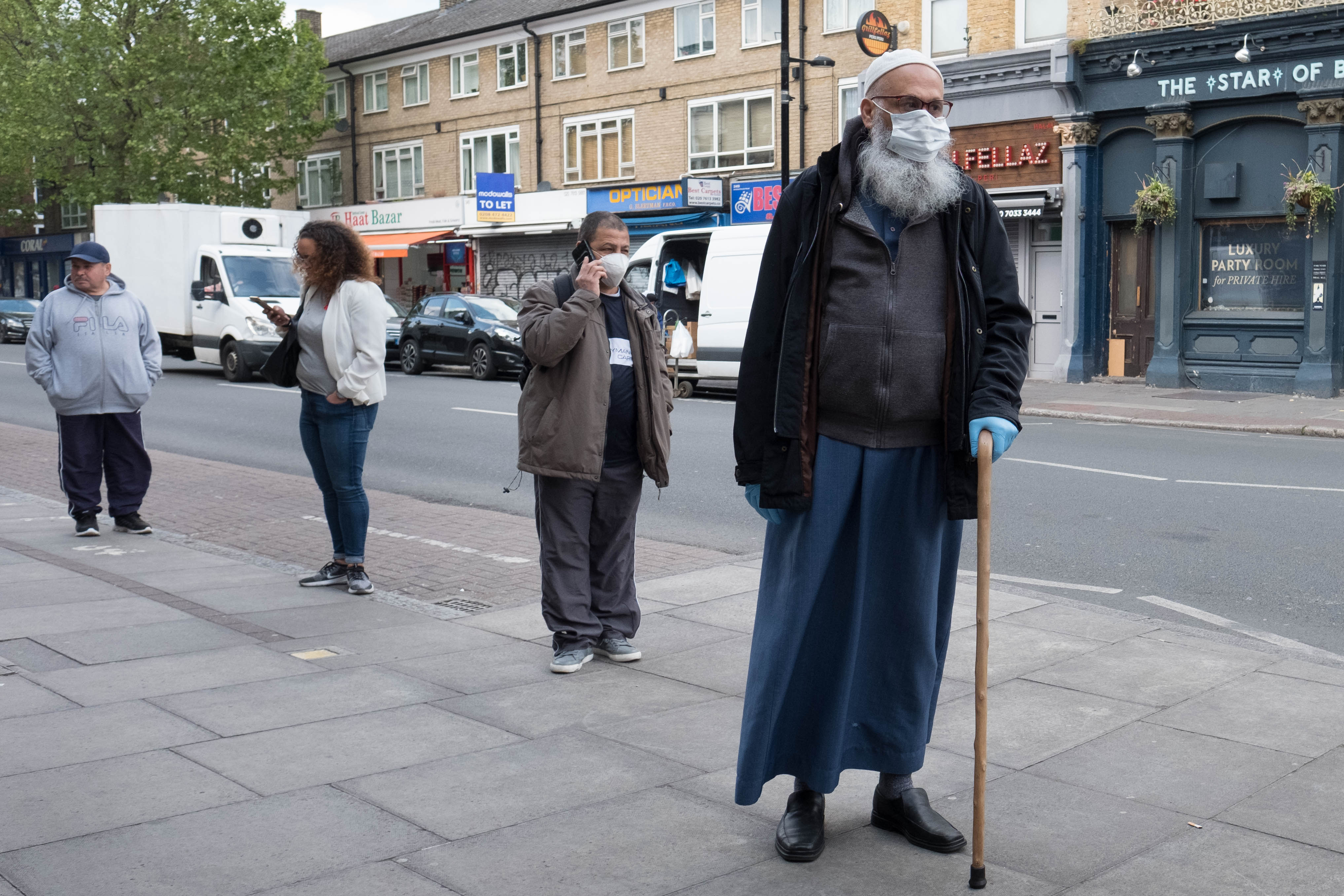 Members of the Islamic community in Bethnal Green, east London go about their daily business during the holy month of Ramadan as the UK continues in lockdown to help curb the spread of the coronavirus.