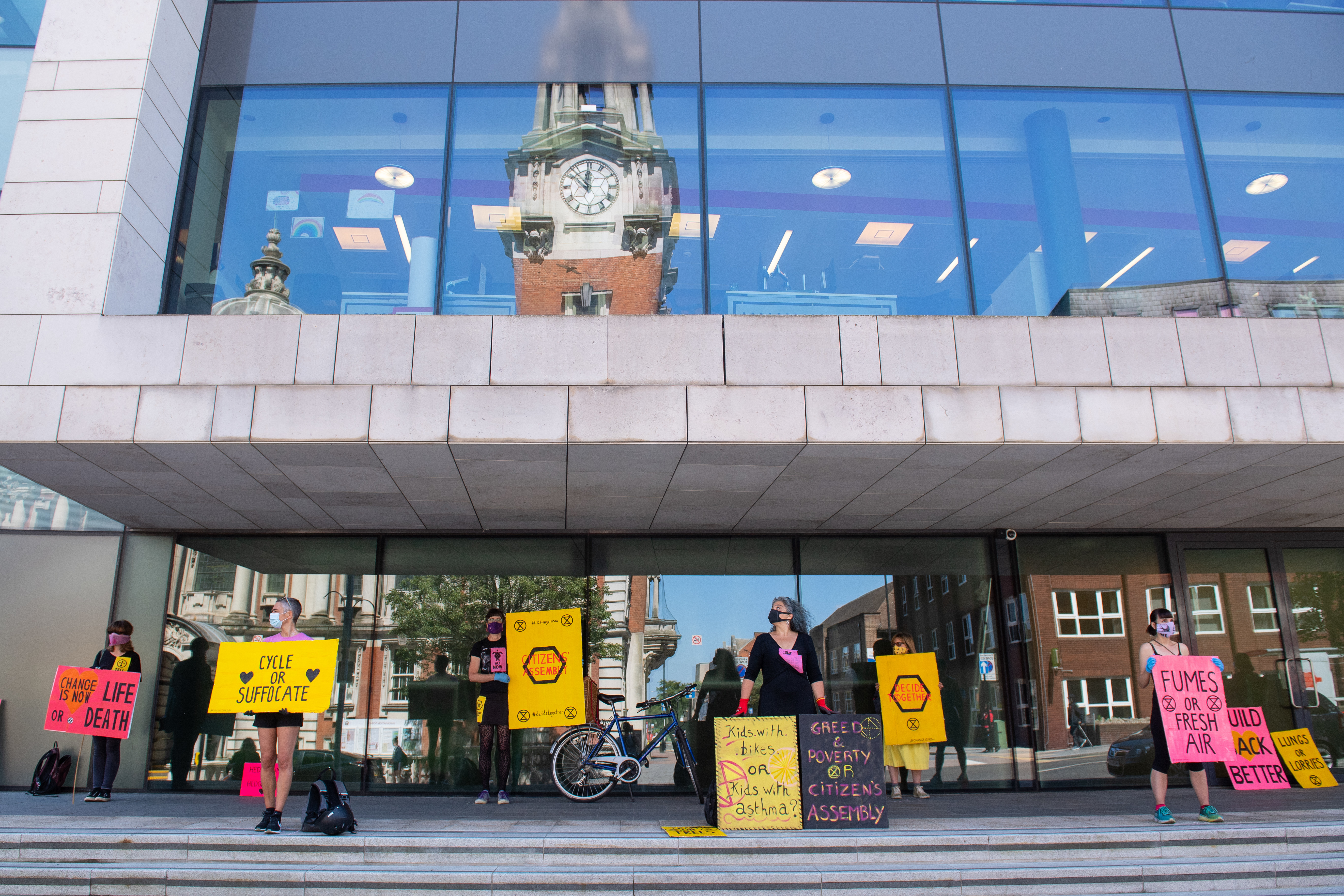 Extinction Rebellion activists stage a socially distanced protest outside the Woolwich Centre, in south London, calling on the council to better respond to Covid-19 and climate change.