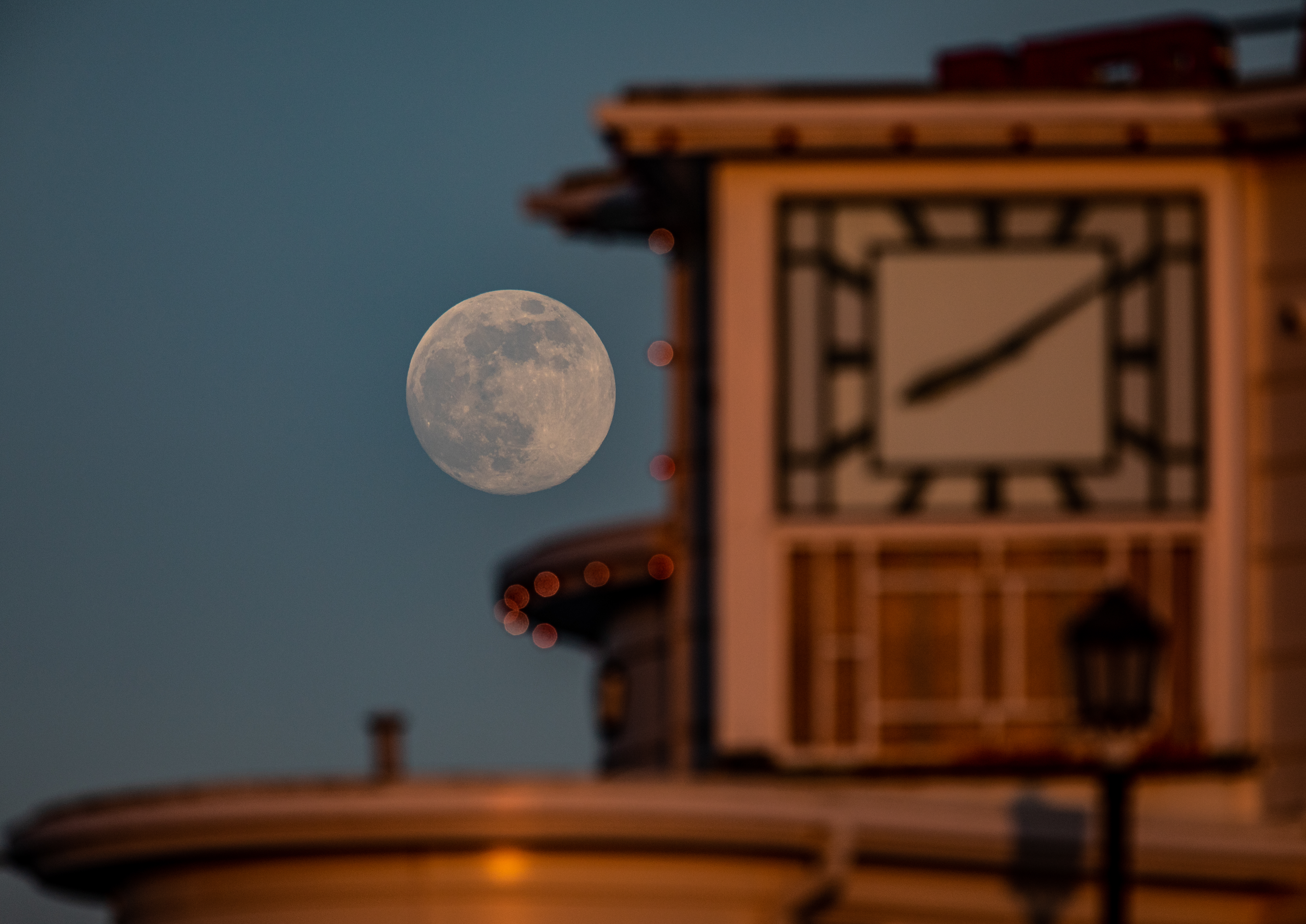 """The beach as the moon rises over Worthing Pier in West Sussex, ahead of the final supermoon of the year, which will be visible over the UK on Thursday evening. The full moon in May is also known as the """"flower moon"""", signifying the flowers that bloom during the month."""