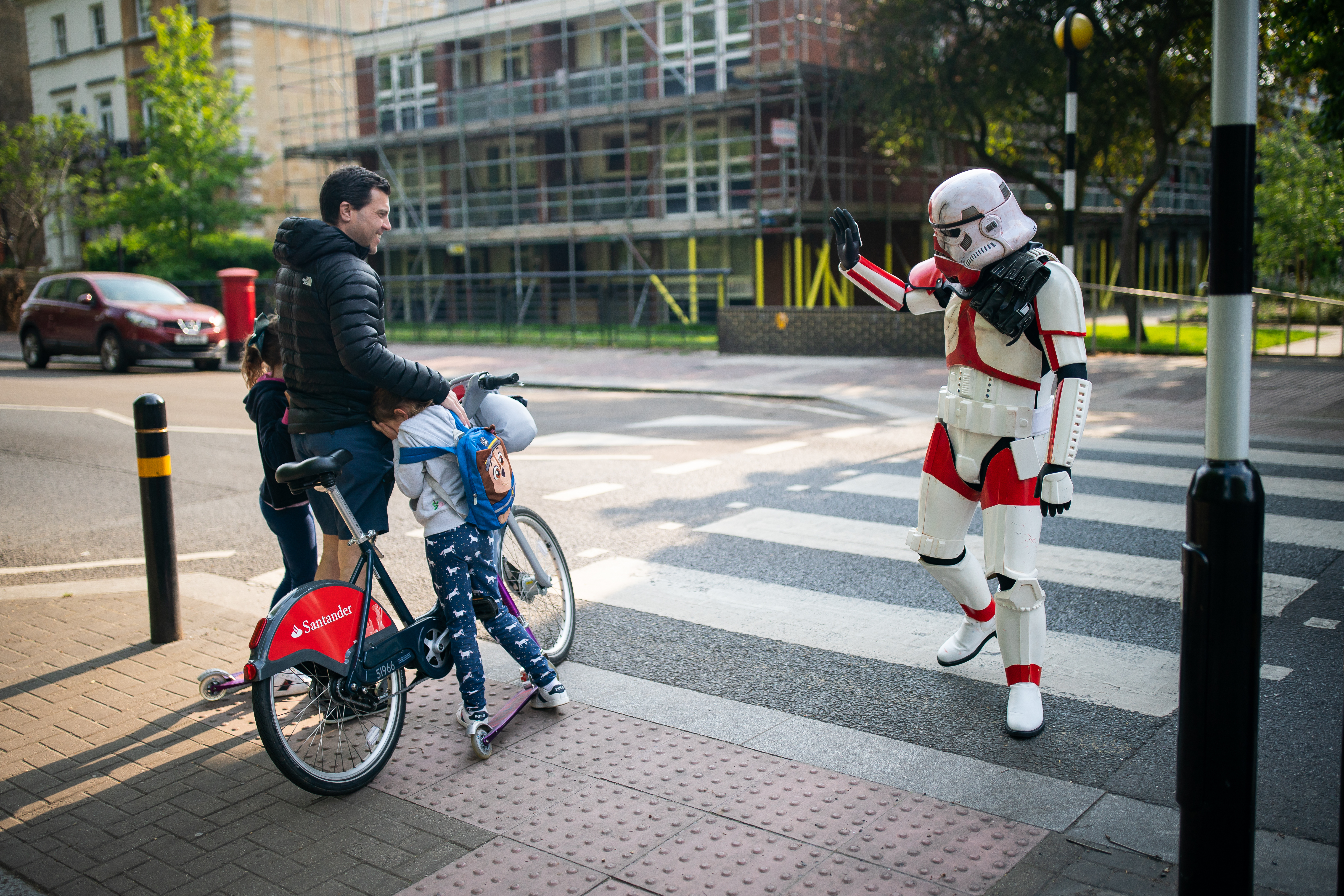 Sam Orchard dressed as a Stormtrooper out for for exercise in a South London park on the 4th May Star Wars Day 2020 as the UK continues in lockdown to help curb the spread of the coronavirus.