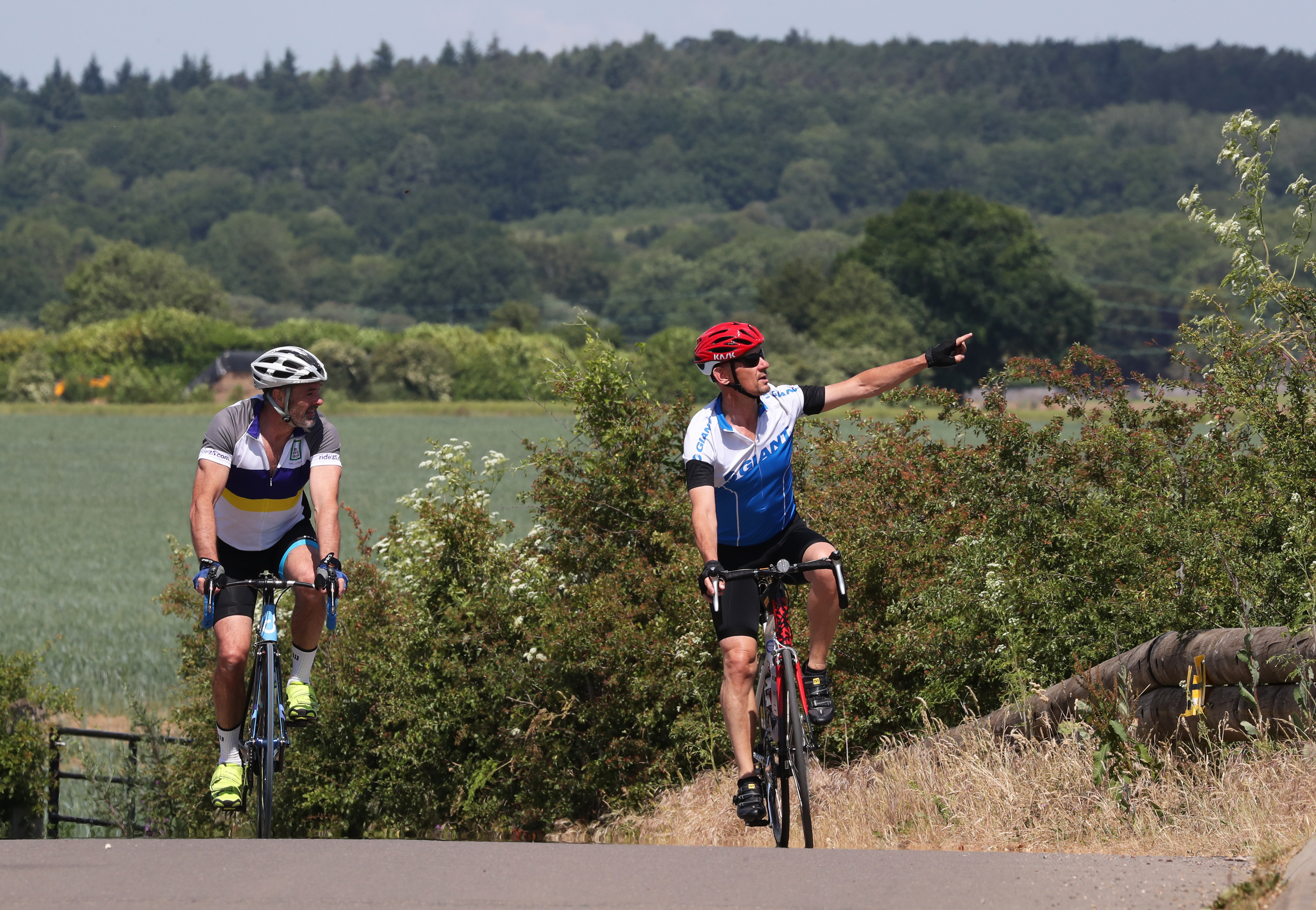 Cyclists cross the railway bridge in White Waltham, Berkshire, as coronavirus lockdown restrictions in England are eased.