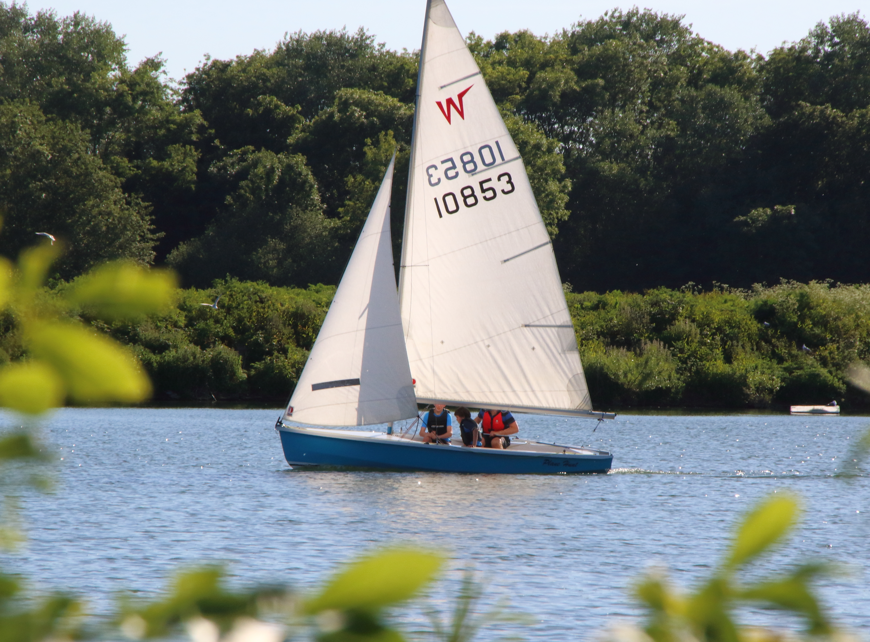 Men sailing on a dinghy at Priory Country Park Lake following the ease of restrictions on forms of exercise during the COVID 19 Lockdown as temperatures hit 27 degrees C, the hottest day of the year in the UK. (Photo by Keith Mayhew / SOPA Images/Sipa USA)