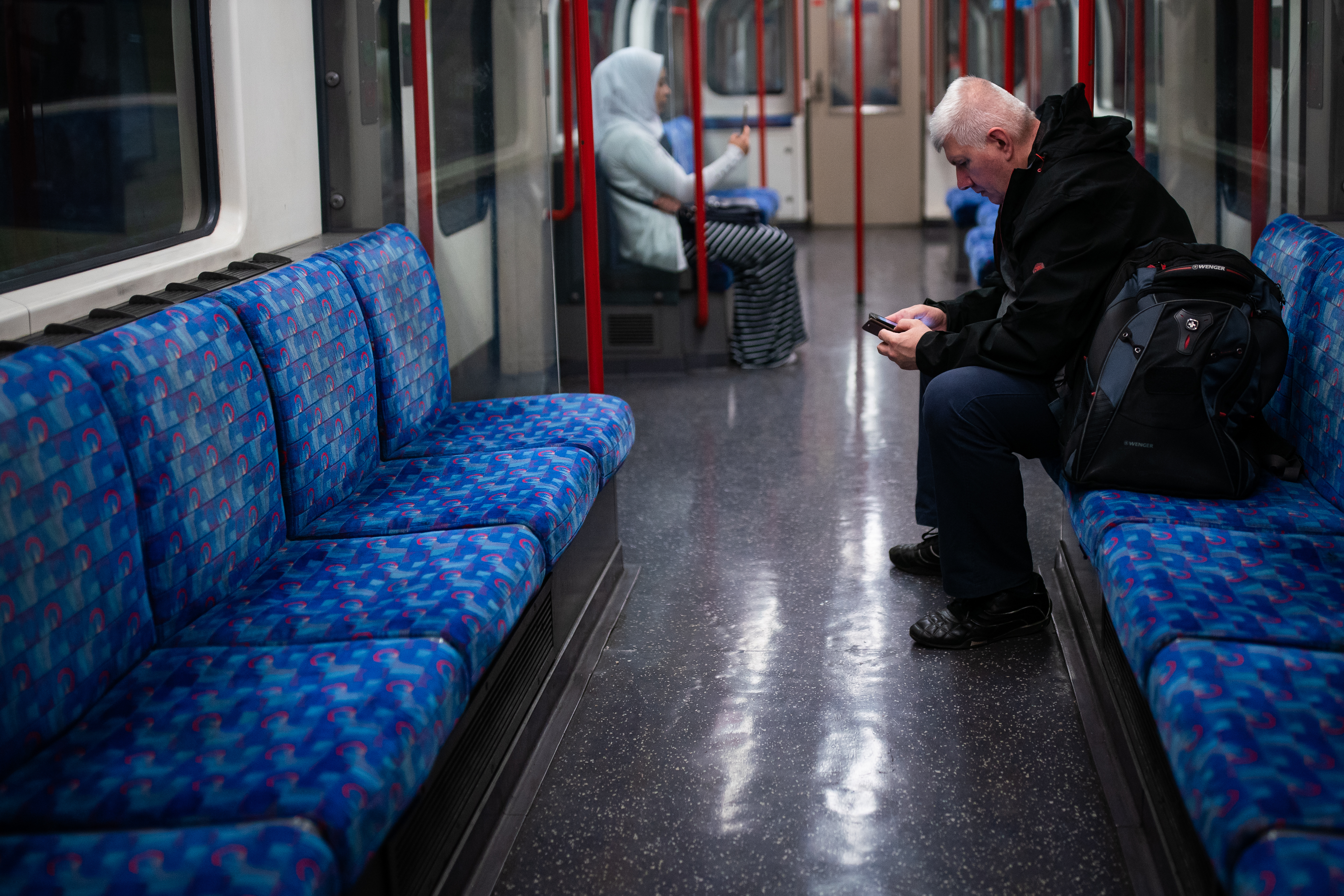 Members of the public stay socially distant on the Central Line as the UK continues in lockdown to help curb the spread of the coronavirus.