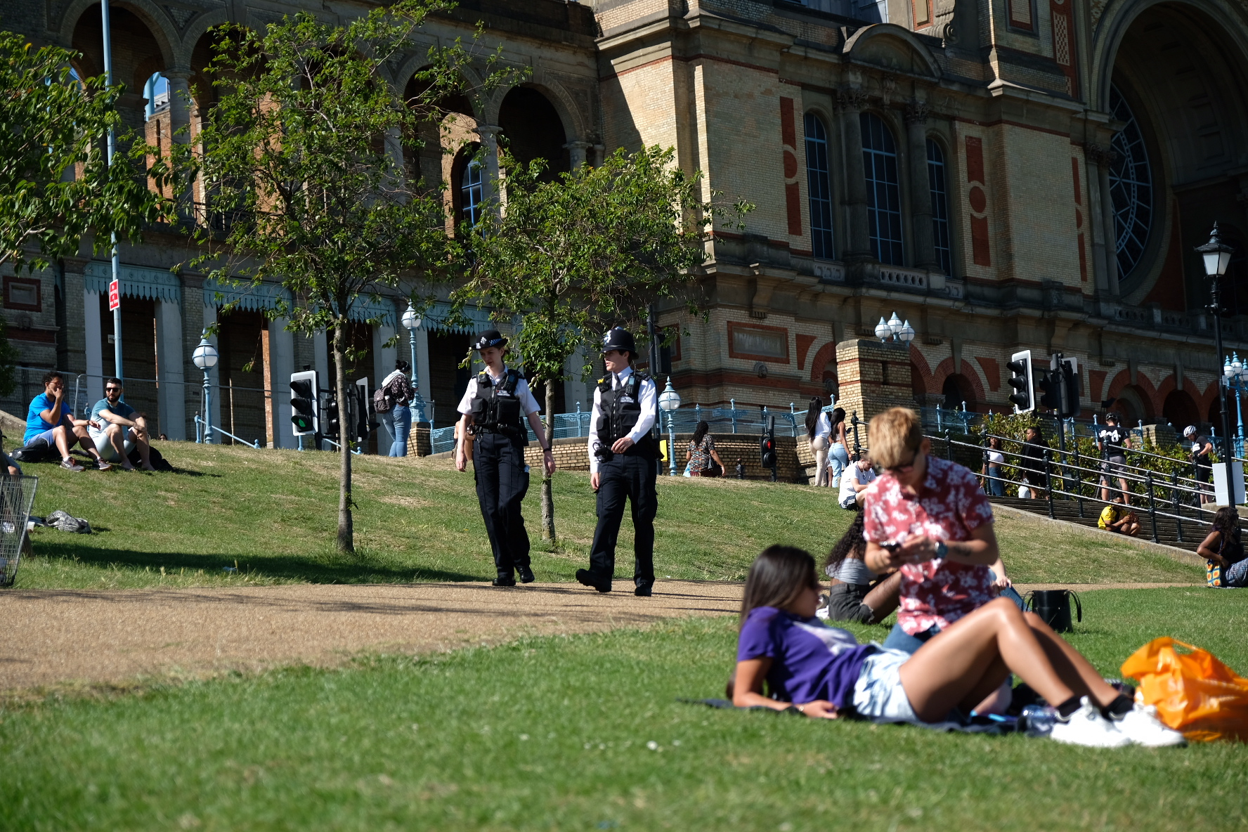 Police officers patrol as people enjoy the weather at Alexandra Palace, London, after the introduction of measures to bring the country out of lockdown. (Photo by Ian Hinchliffe/PA Images via Getty Images)