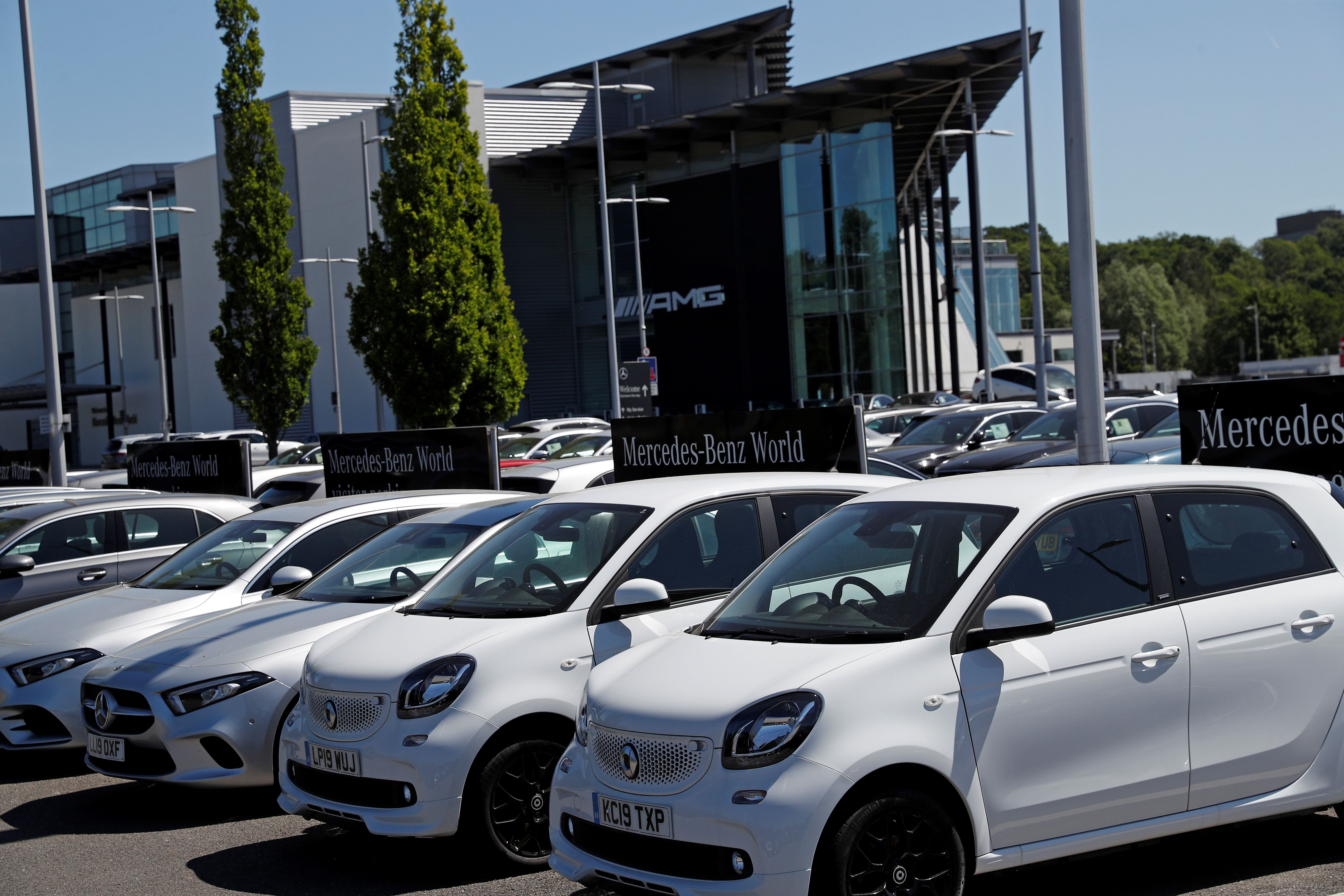 New and used cars are on show at a Mercedes-Benz Brooklands and Mercedes-Benz World car dealership near Woking, southwest England on May 29, 2020. - The motor trade is calling for the UK to introduce a car scrappage scheme to help jump-start the economy and replace older, more polluting models. (Photo by ADRIAN DENNIS / AFP) (Photo by ADRIAN DENNIS/AFP via Getty Images)