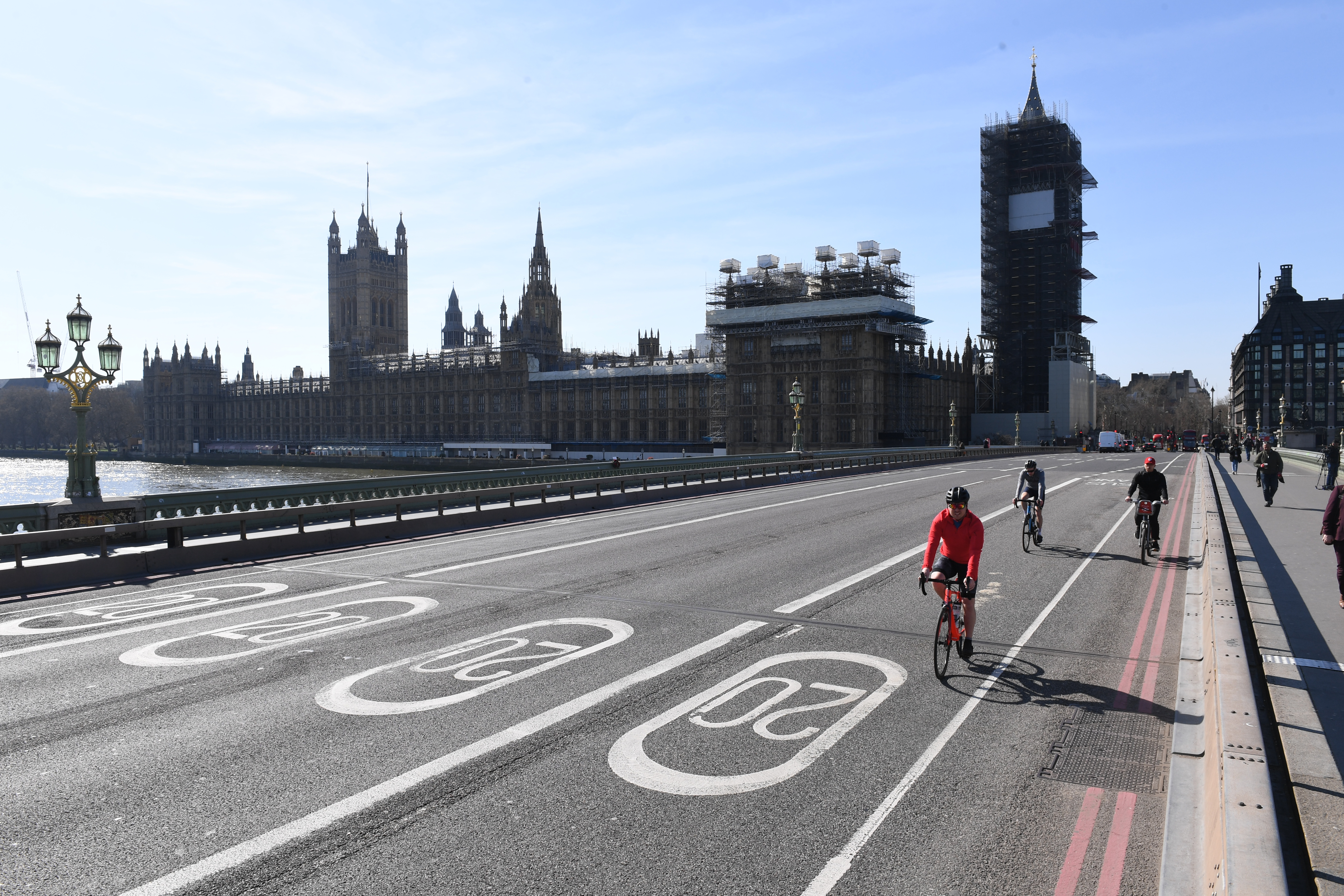 File photo dated 24/03/20 of cyclists riding across an empty Westminster Bridge in Westminster, London, the day after Prime Minister Boris Johnson put the UK in lockdown to help curb the spread of the coronavirus. More than a third of people say they could rethink the way they travel after the coronavirus pandemic, a new survey suggests.
