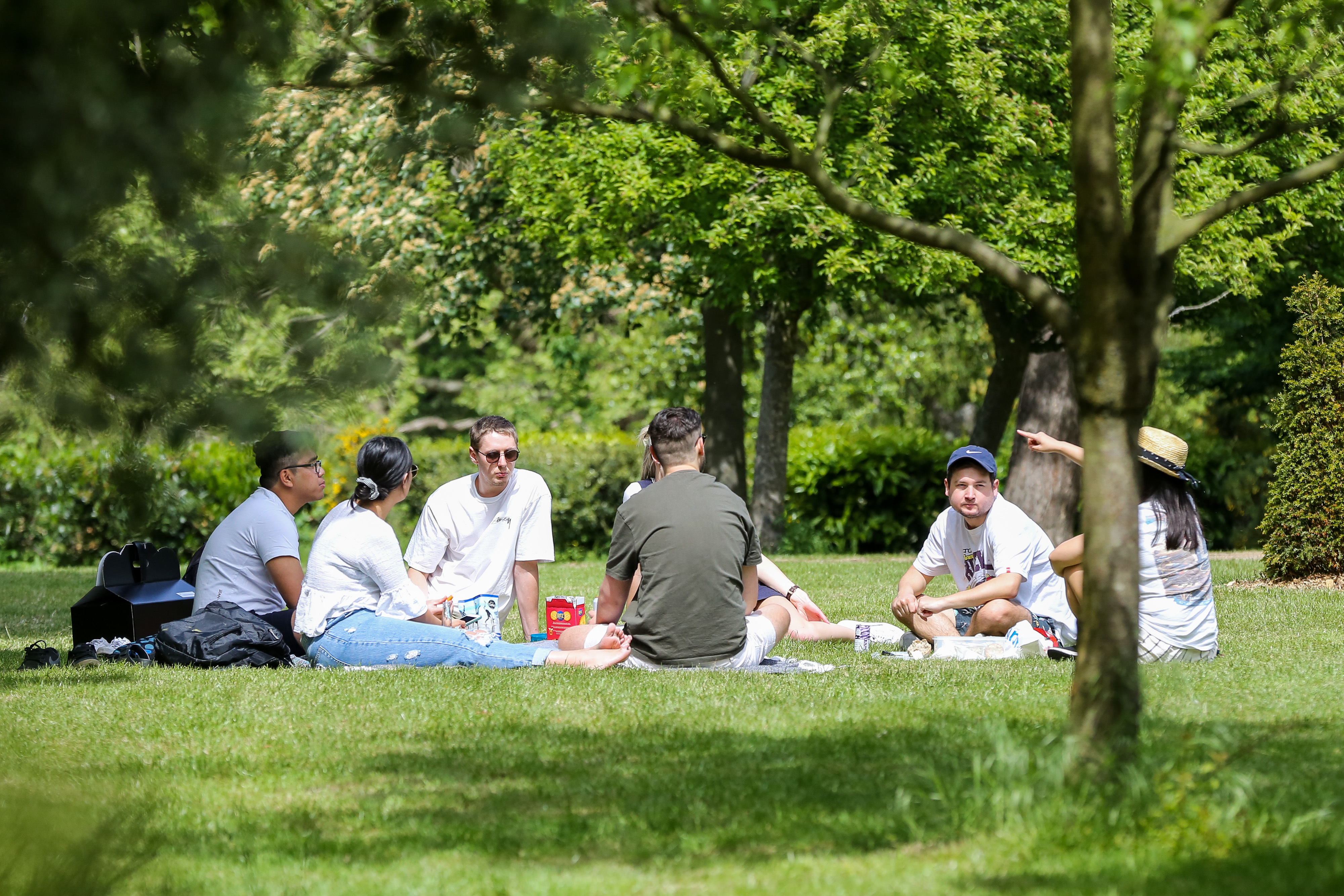 People enjoying the warm weather in Finsbury park during the COVID-19 lockdown as they observe social distancing. The government has relaxed the restrictions on coronavirus lockdown to allowing people to spend more time outside. (Photo by Steve Taylor / SOPA Images/Sipa USA)