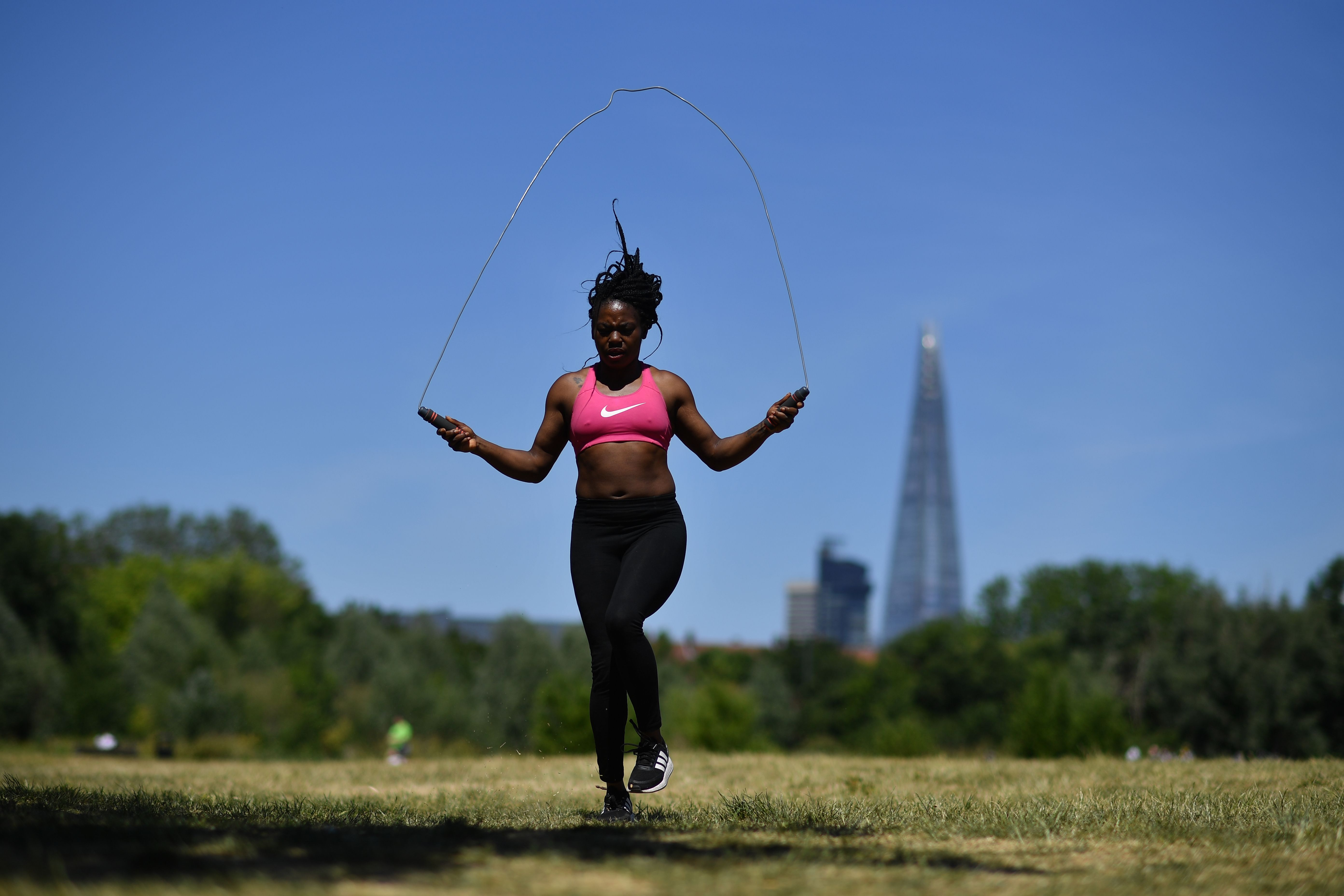 People exercise in Burgess Park in south London on May 29, 2020. (Photo by Ben STANSALL / AFP) (Photo by BEN STANSALL/AFP via Getty Images)