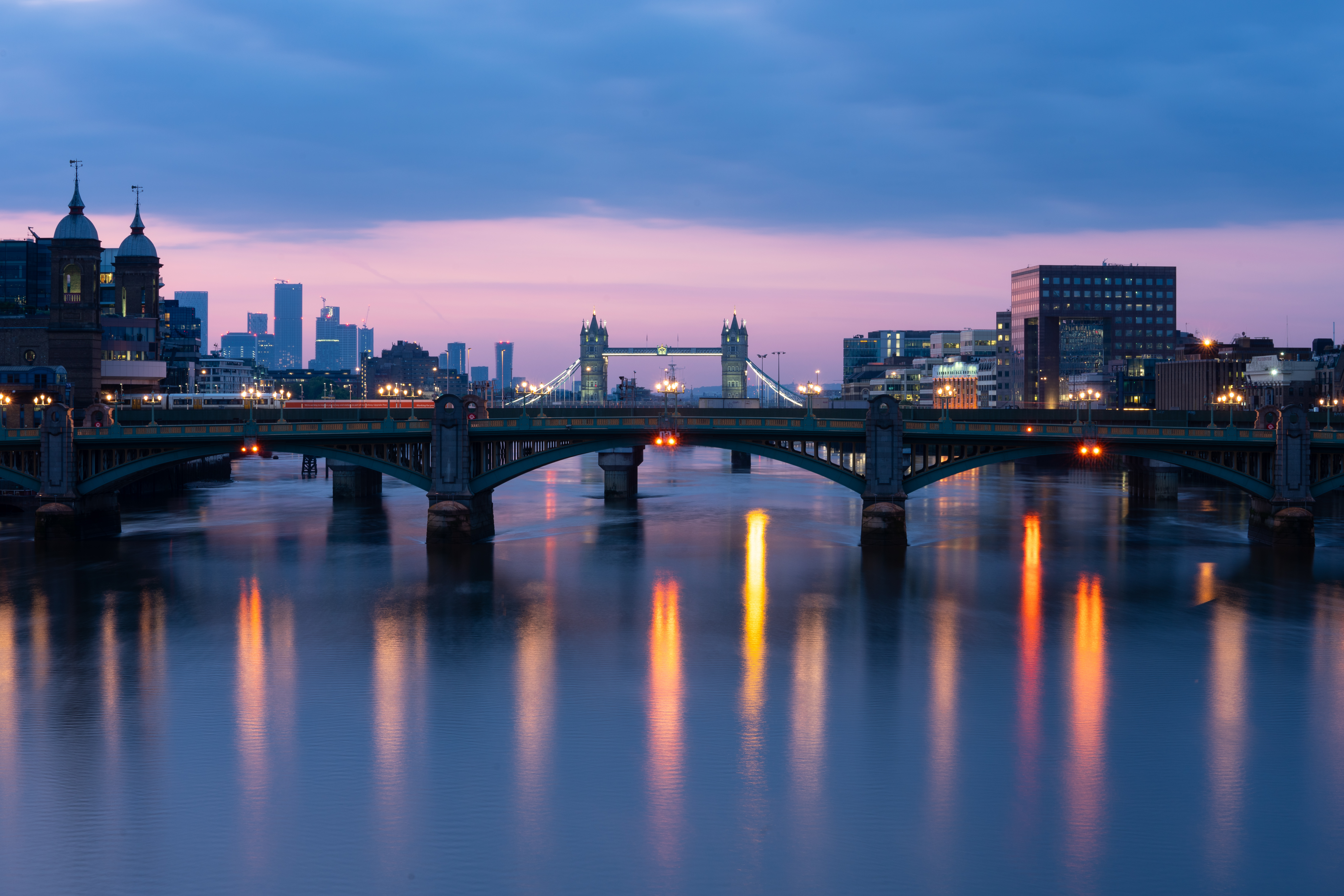 General view of the river Thames in central London at dawn, showing Southwark Bridge, Tower Bridge, and skyscrapers at Canary Wharf, after the introduction of measures to bring the country out of lockdown. (Photo by Dominic Lipinski/PA Images via Getty Images)