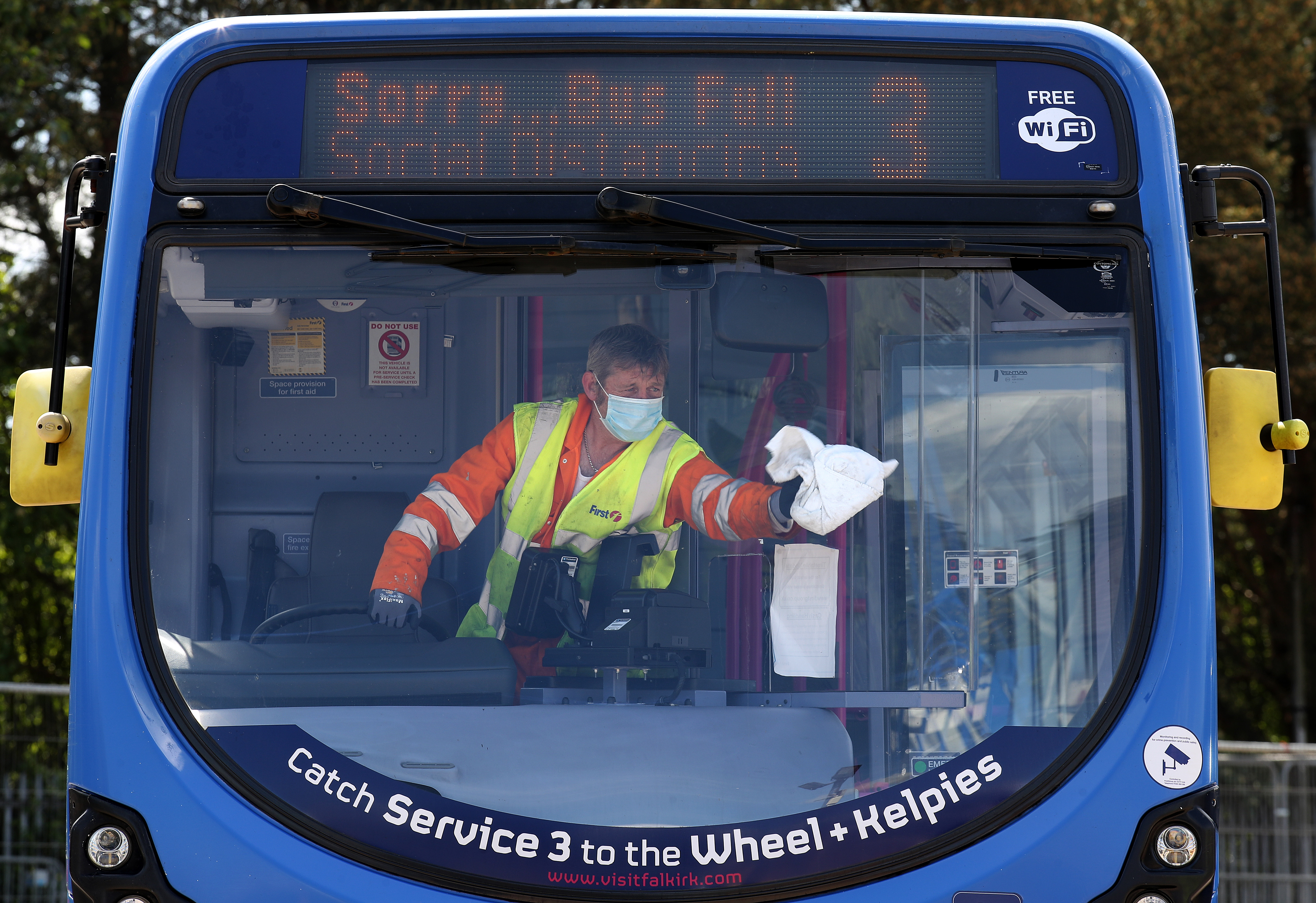 Cleaner James York from First Bus cleans a bus at their Larbert depot ahead of the bus returning to service. Due to social distancing measures only a certain amount of people will be able to travel on a particular bus at a certain time after the introduction of measures to bring the country out of lockdown. (Photo by Andrew Milligan/PA Images via Getty Images)