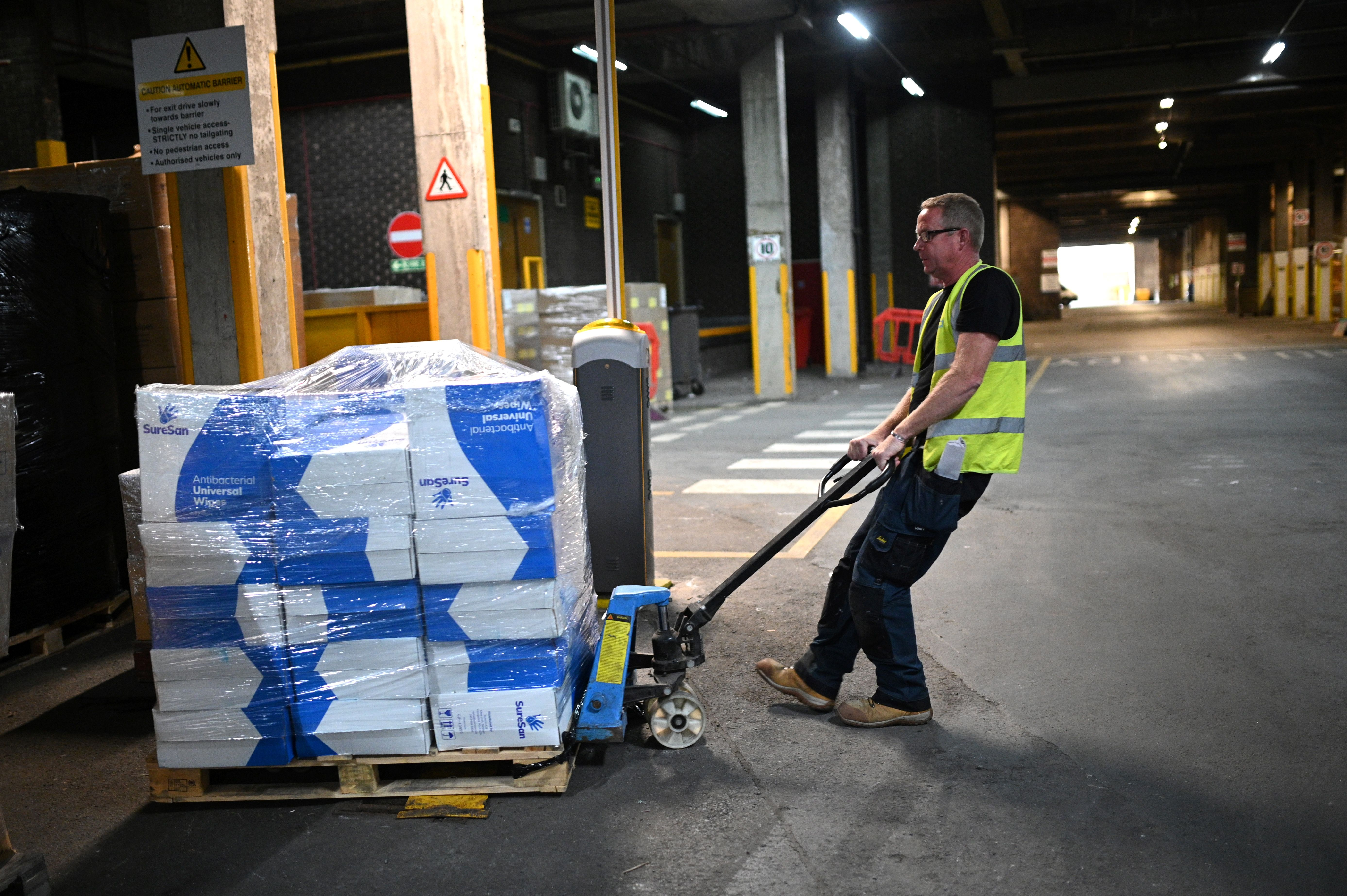 Kirklees council employees prepares orders of Personal Protective Equipment (PPE) at its hub where they will be dispatched to various council run settings in Huddersfield, northwest England on May 28, 2020. (Photo by Oli SCARFF / AFP) (Photo by OLI SCARFF/AFP via Getty Images)